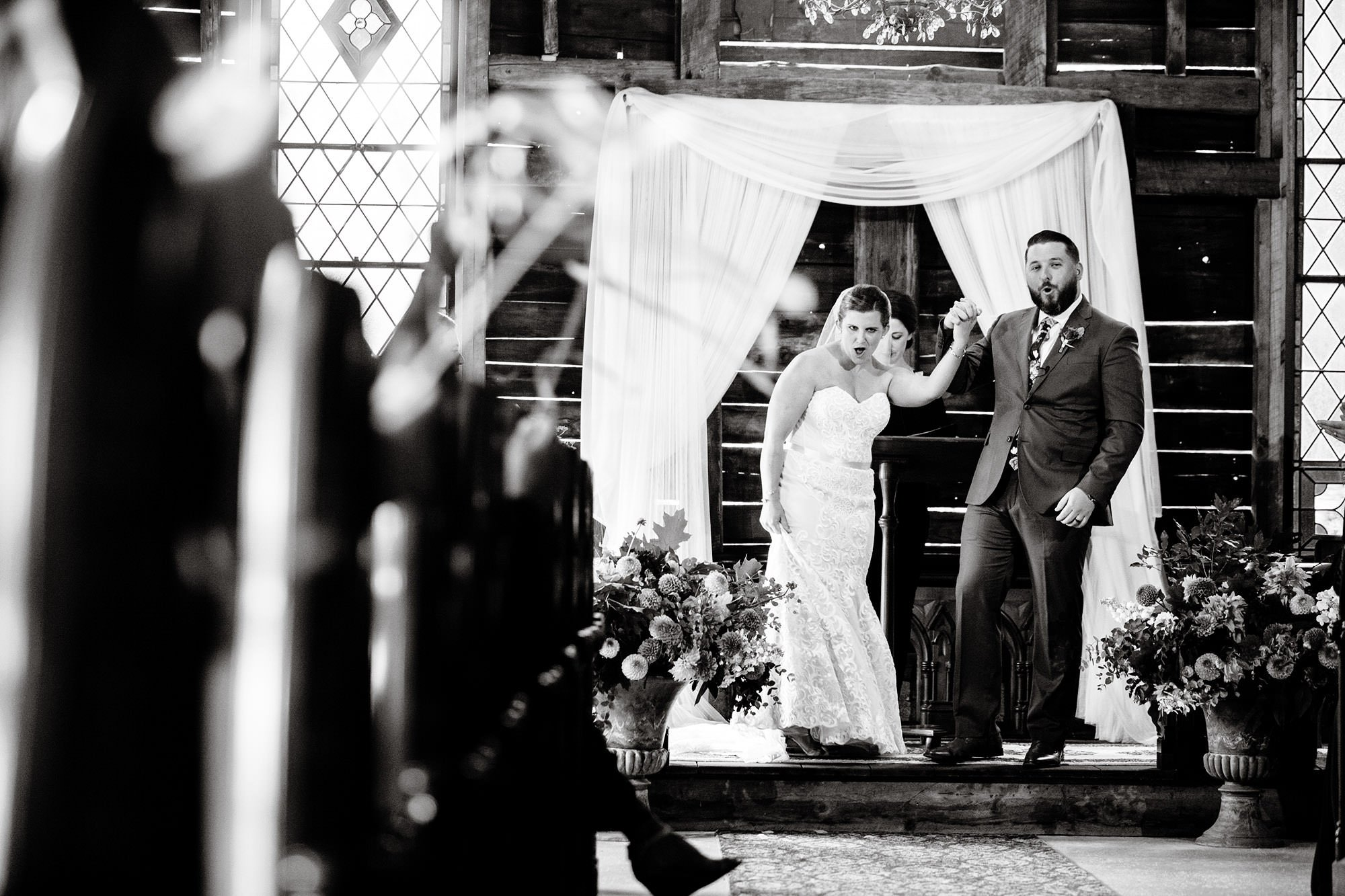 The bride and groom cheer following the ceremony of their Bishop Farm wedding.