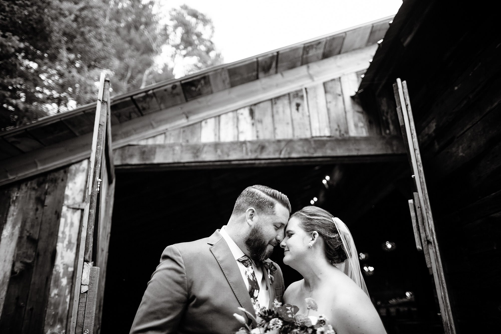 The bride and groom pose on their Bishop Farm wedding day.