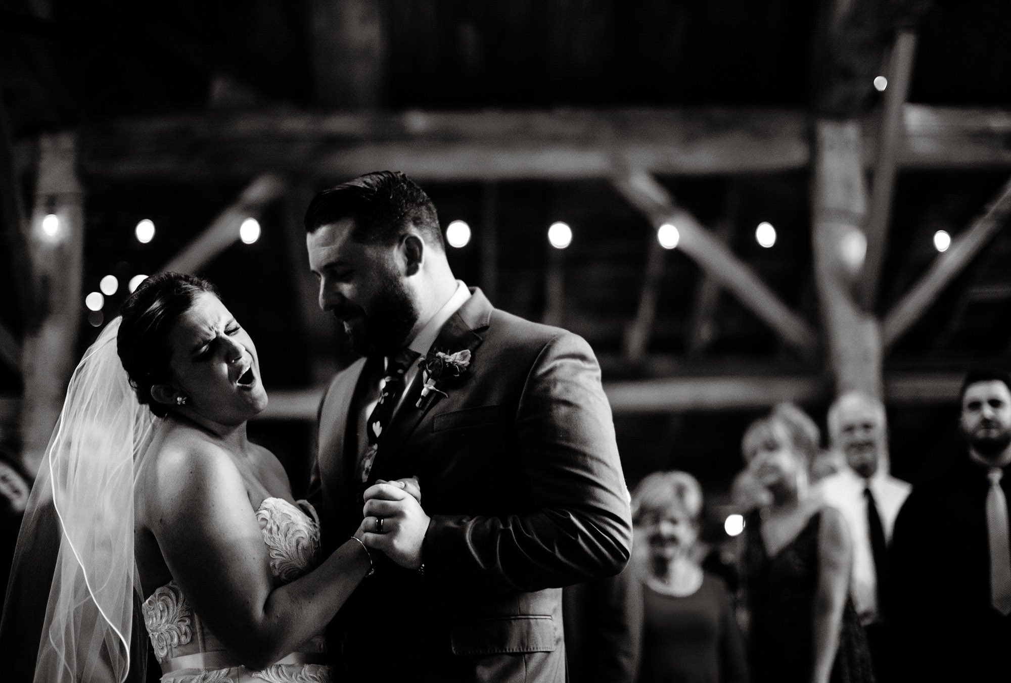 The couple enjoys their first dance during their Bishop Farm wedding.