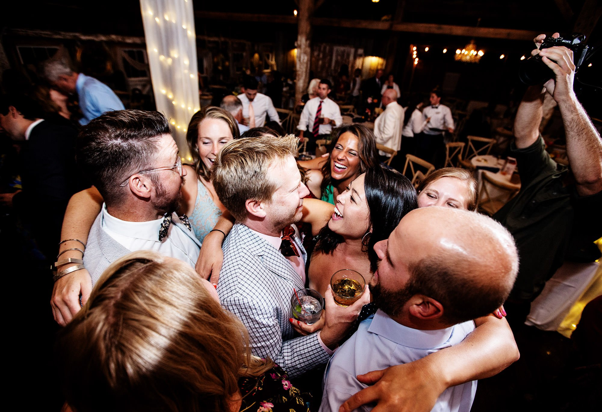 Guests dance during the wedding reception at Bishop Farm.