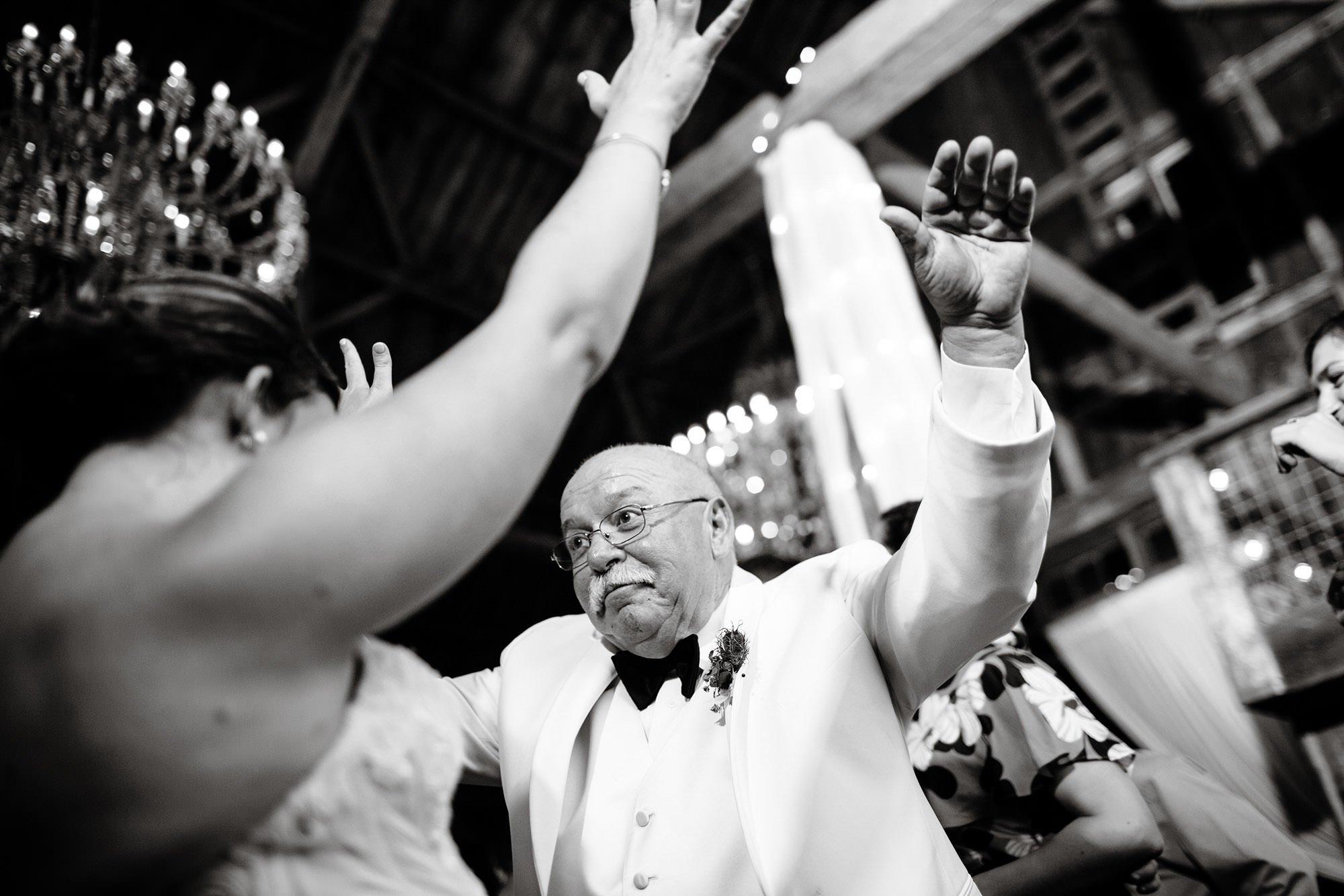Guest enjoy the wedding reception at Bishop Farm.