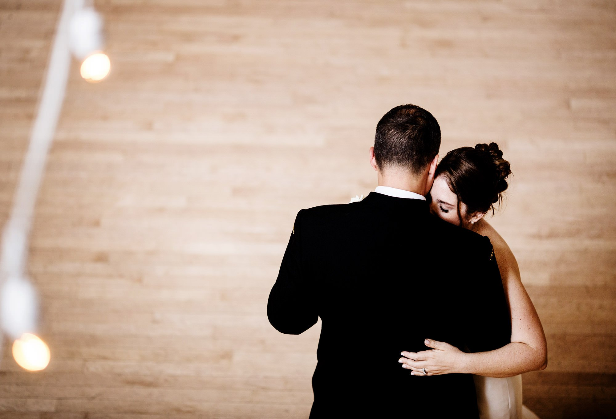 The bride and groom share their first dance at their Exchange Conference Center wedding in Boston.