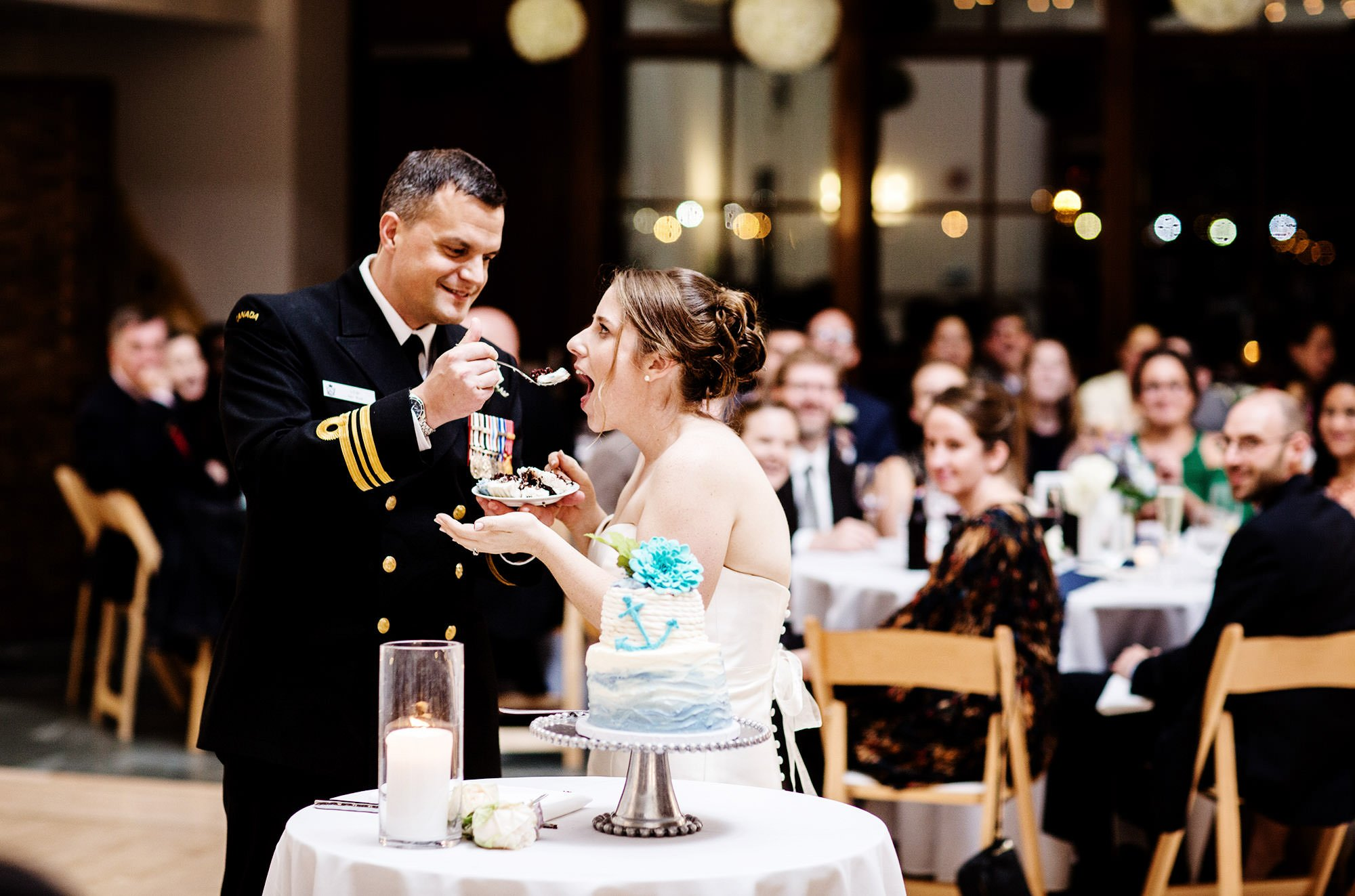 The bride and groom cut their wedding cake at Exchange Conference Center in Boston.
