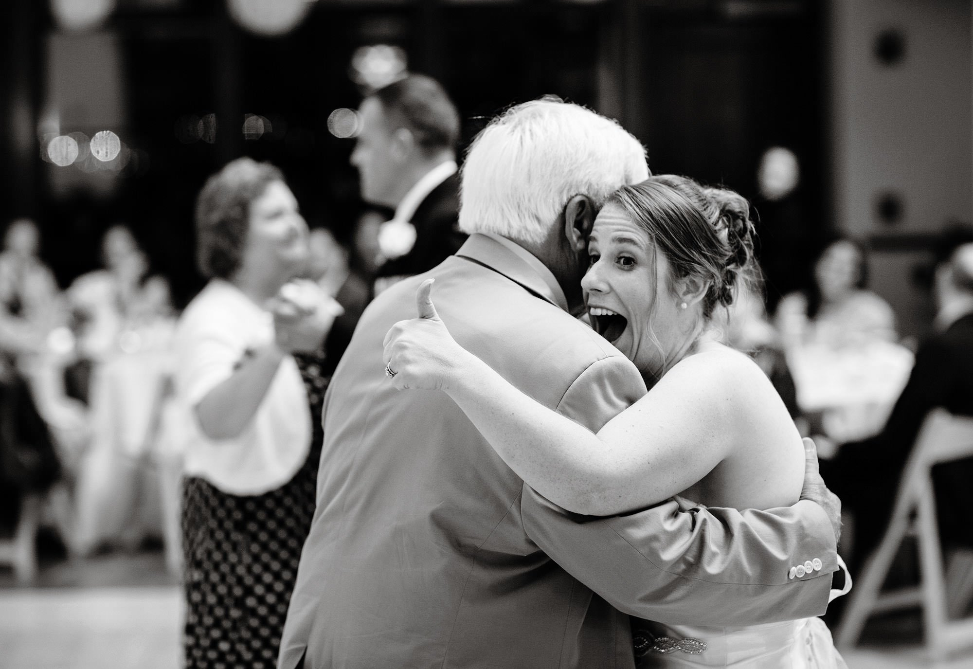 The bride dances with her father at her Exchange Conference Center wedding in Boston.