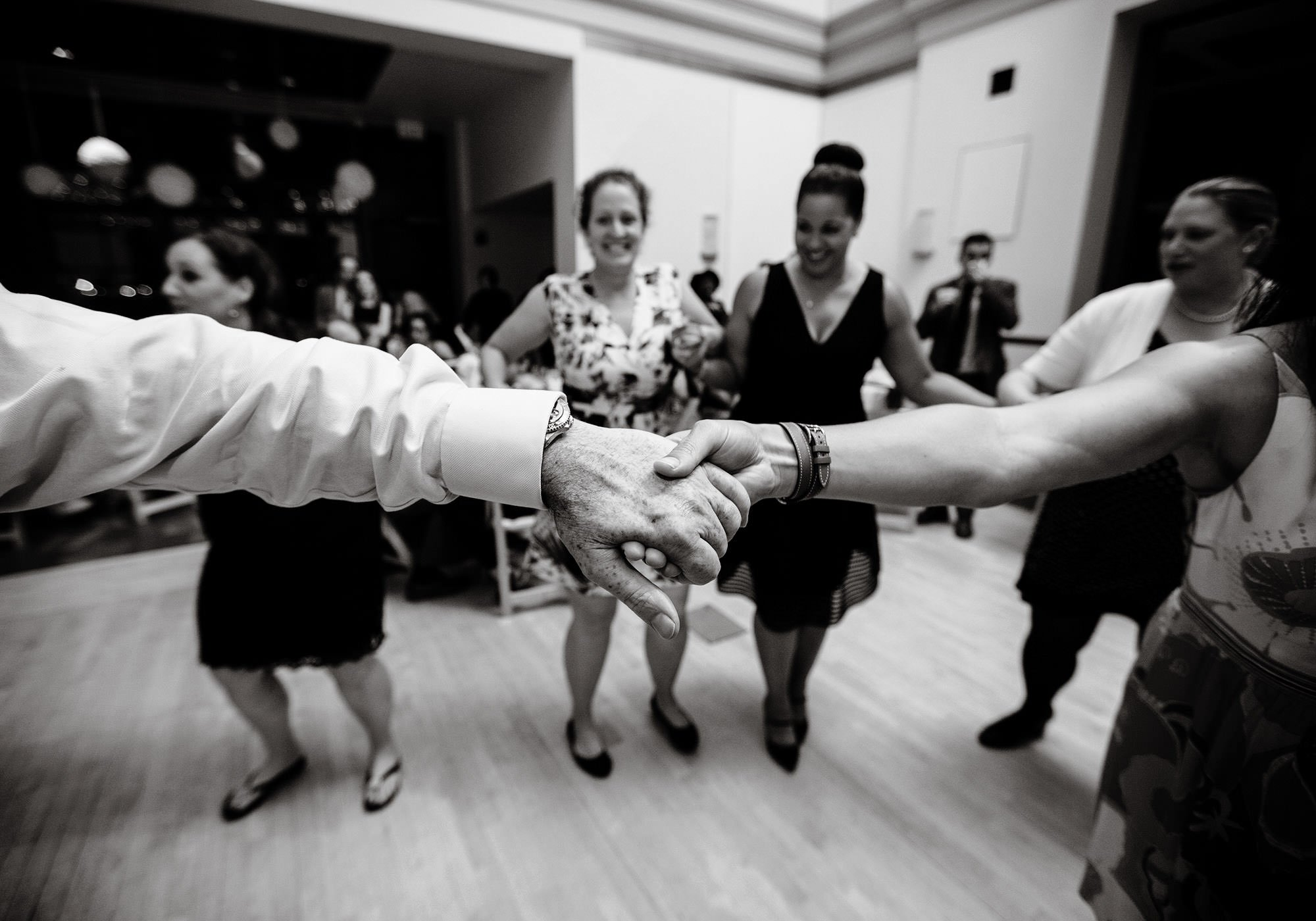 Guests dance during the wedding reception at Exchange Conference Center in Boston.