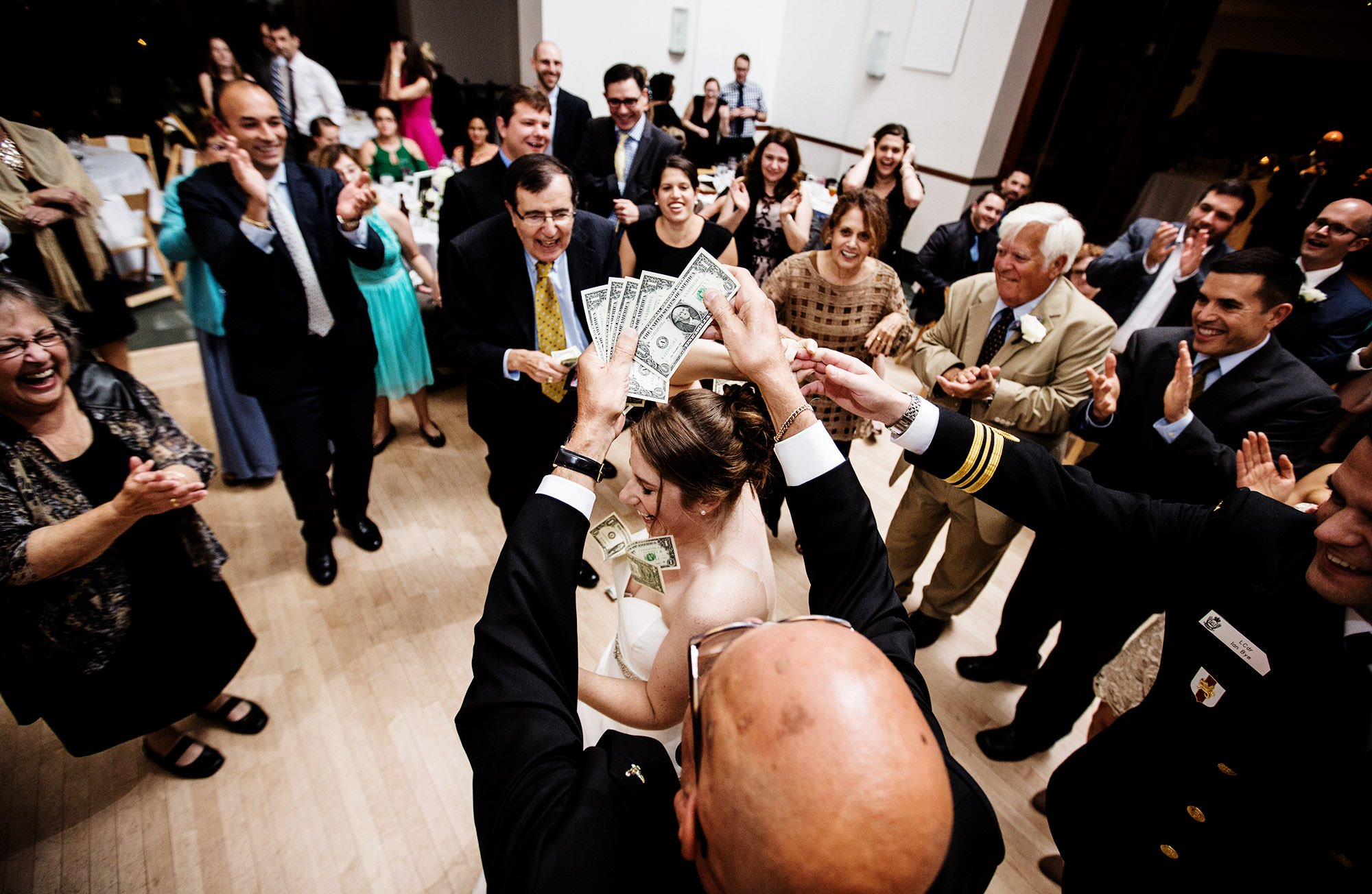 Guests shower the bride with money during the wedding reception at Exchange Conference Center in Boston.