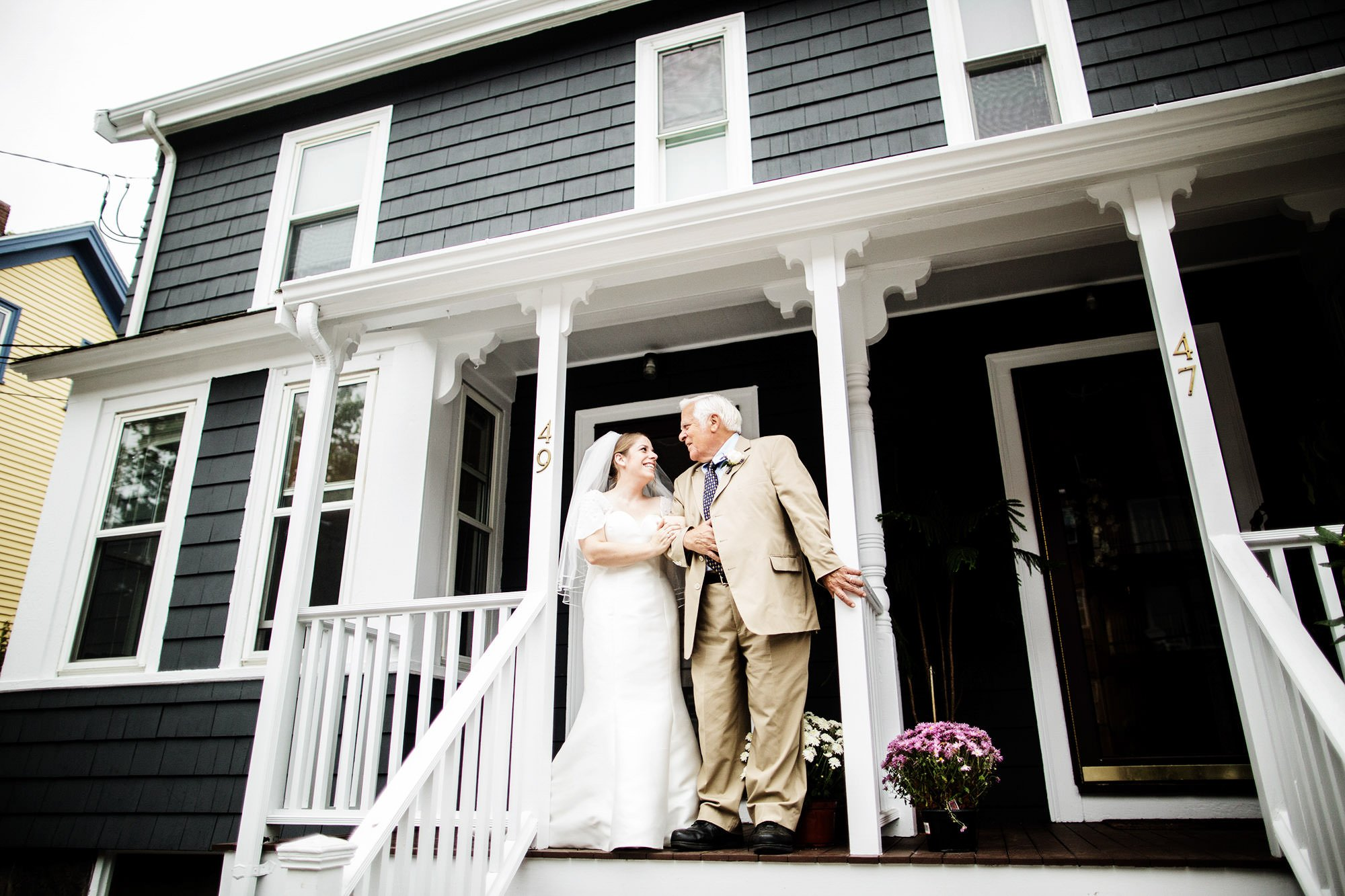 The bride shares a moment with her father at her childhood home before her Exchange Boston wedding.