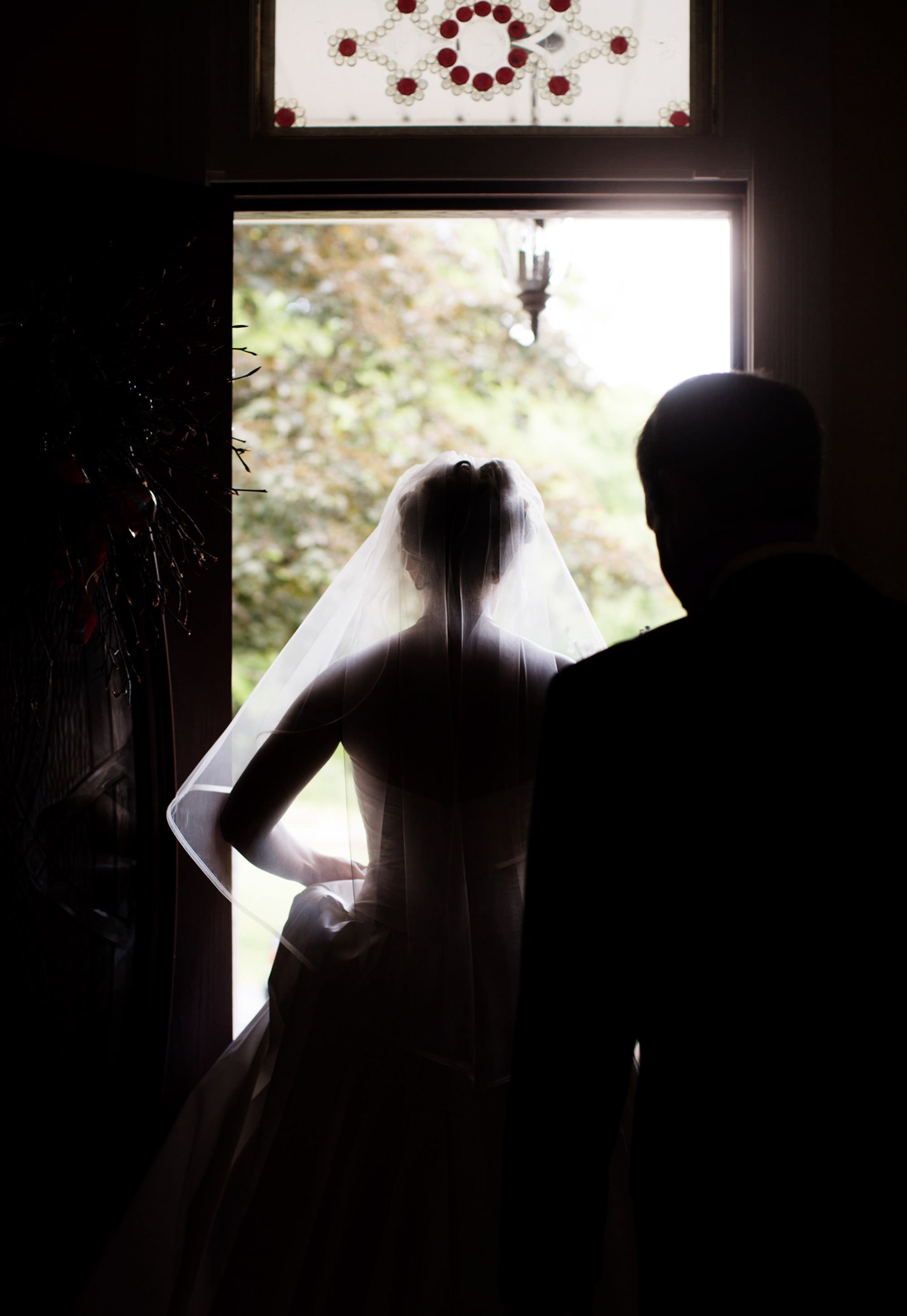 The bride prepares for her ceremony at her Chanteclaire Farm Wedding.