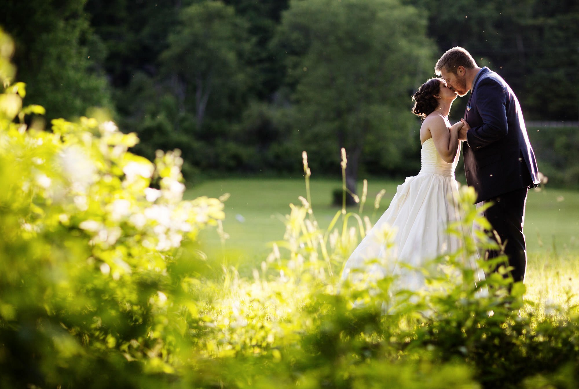 The bride and groom pose for a portrait during their Chanteclaire Farm Wedding.