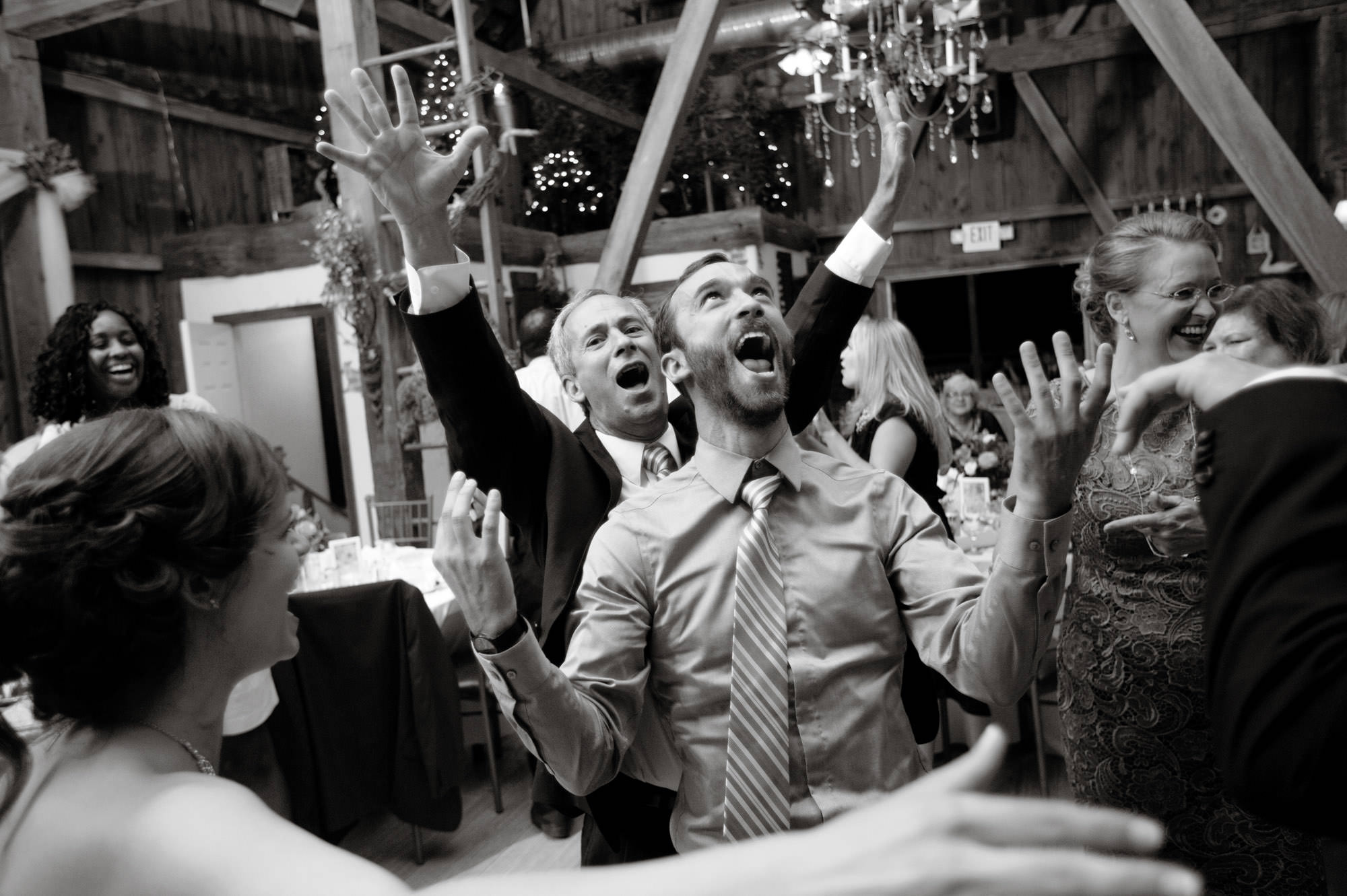 Guests dance during this Chanteclaire Farm Wedding.