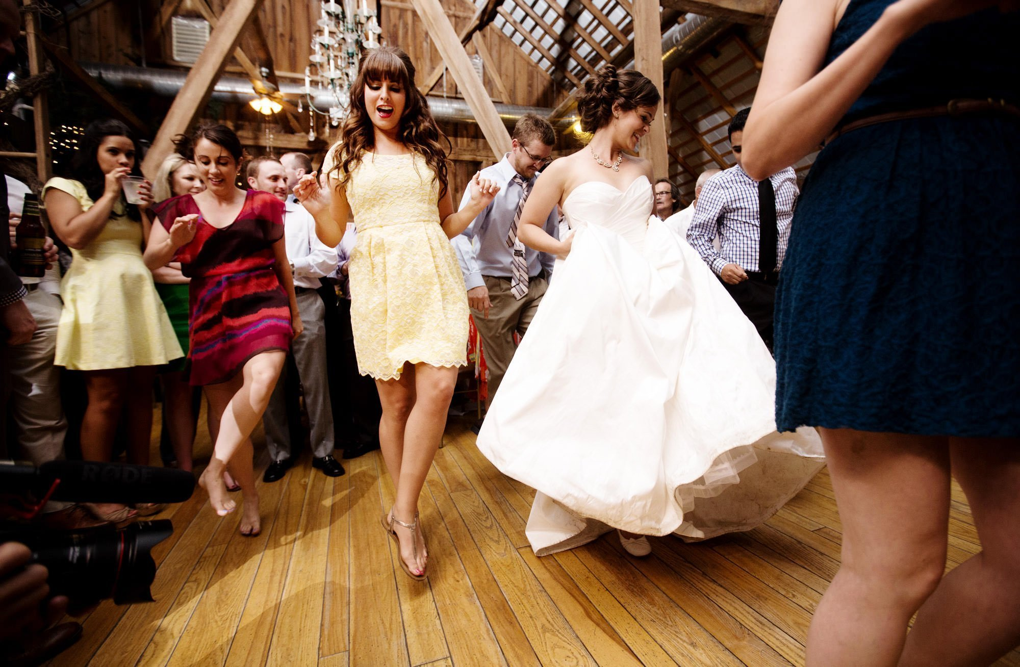 Guests dance during the wedding reception at Chanteclaire Farm.