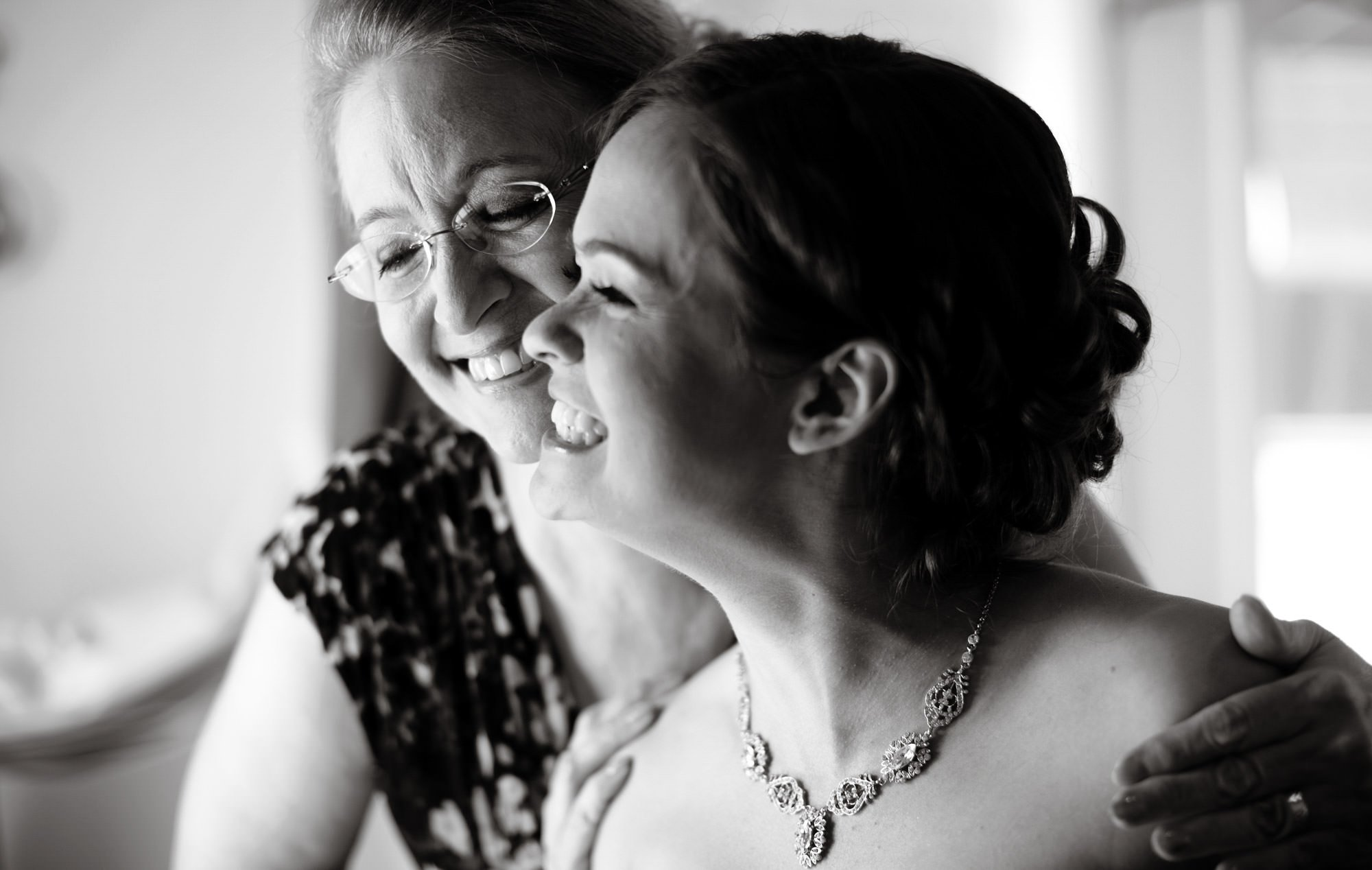 The bride smiles with her mother prior to her Chanteclaire Farm Wedding.
