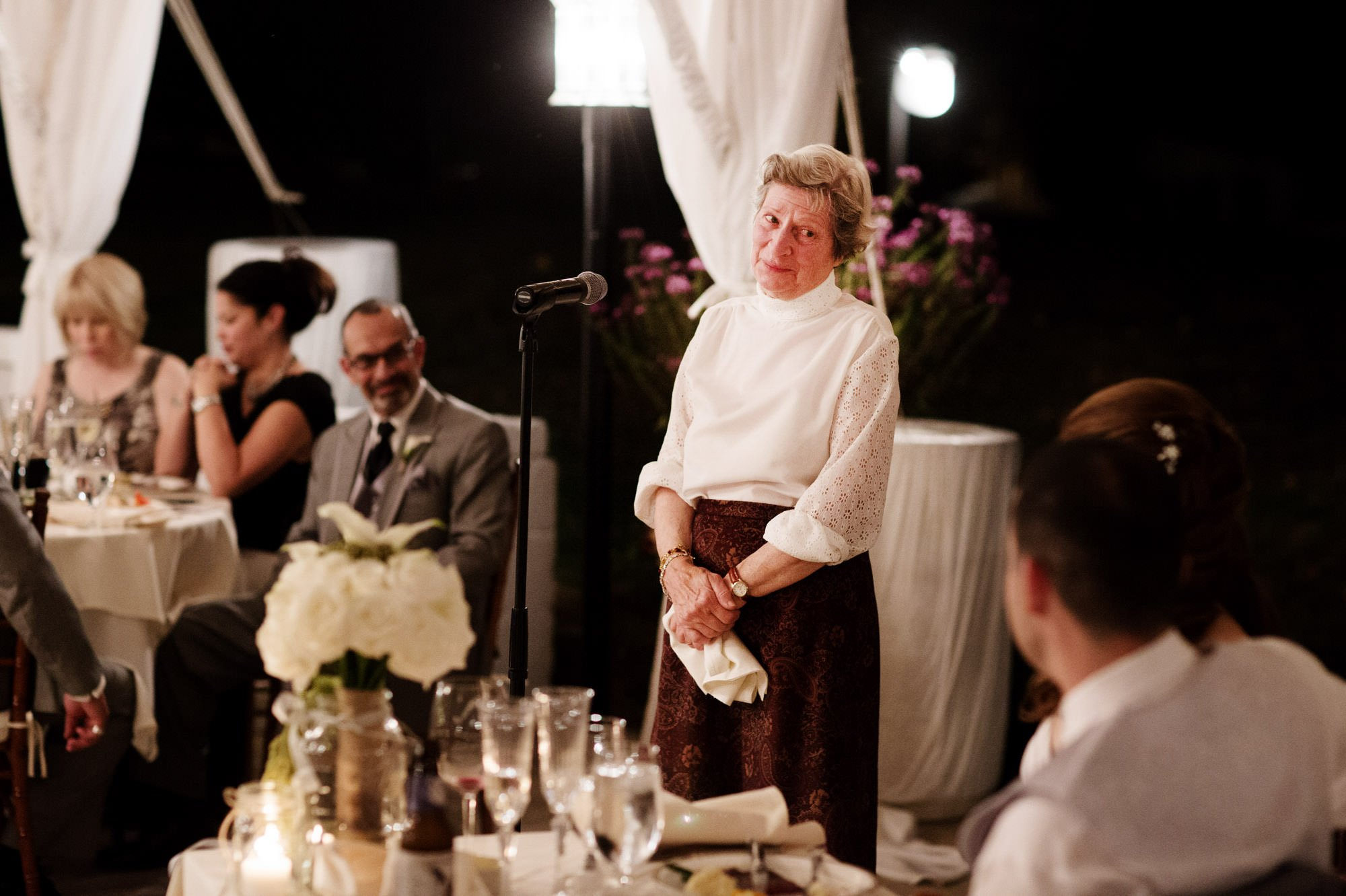 Toasts are given during the tented reception at this Comus Inn wedding.