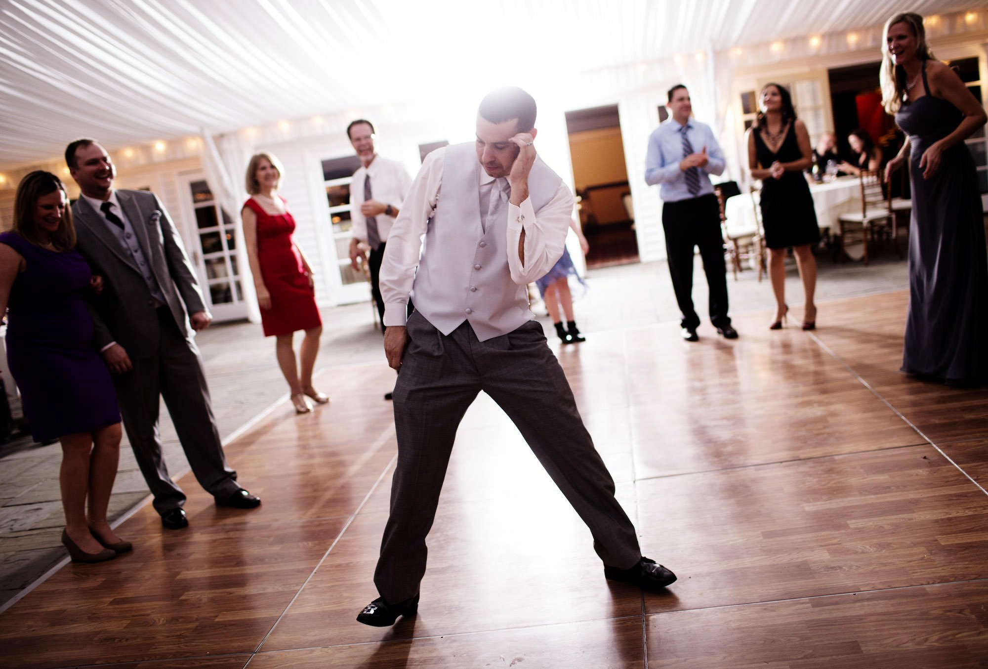 The groom dances during the wedding reception at Comus Inn.