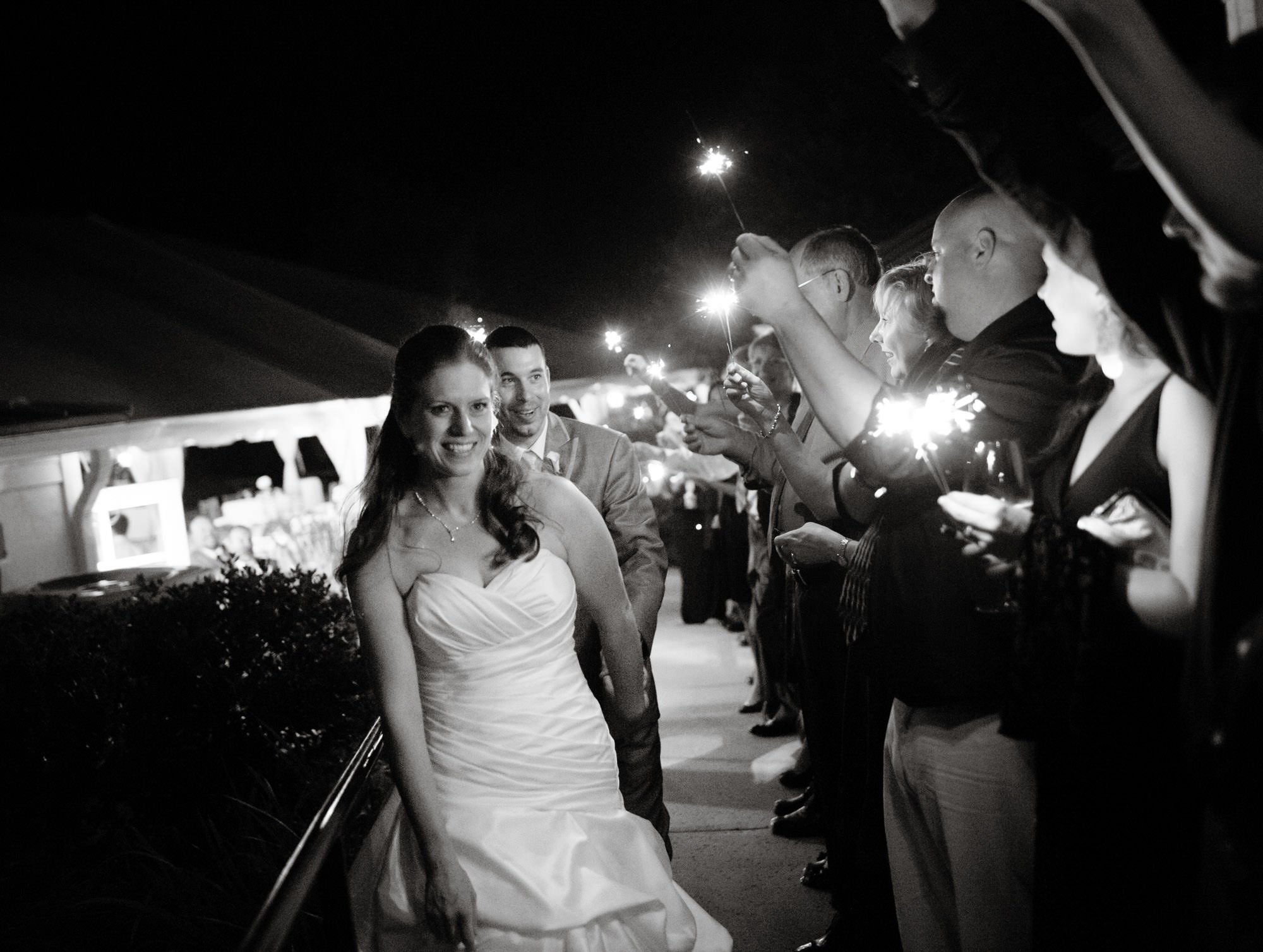 The bride and groom run through sparklers at the conclusion of their Comus Inn wedding.