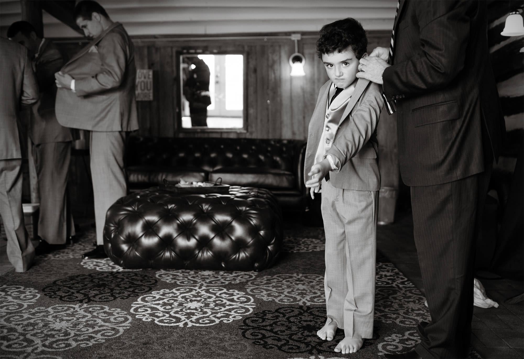 An unhappy ring bearer puts on his suit during this Comus Inn wedding.
