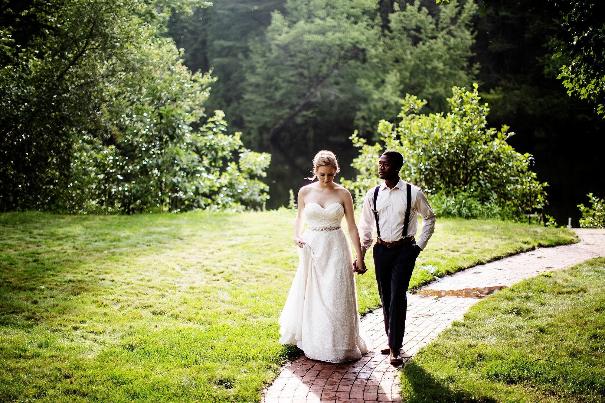 The bride and groom walk after their ceremony during their New Hampshire backyard wedding.