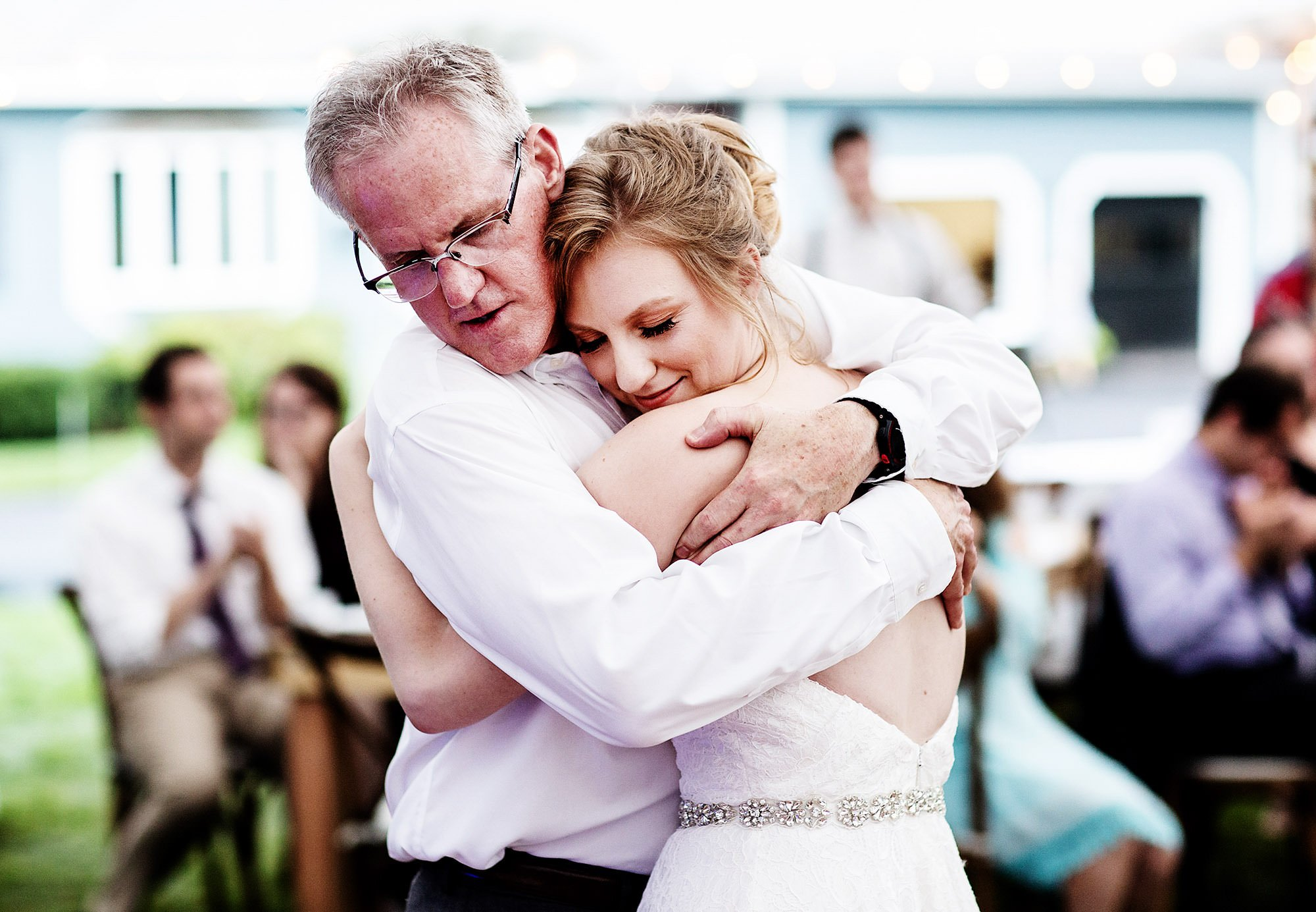 New Hampshire Backyard Wedding  I  The bride hugs her dad during their dance.