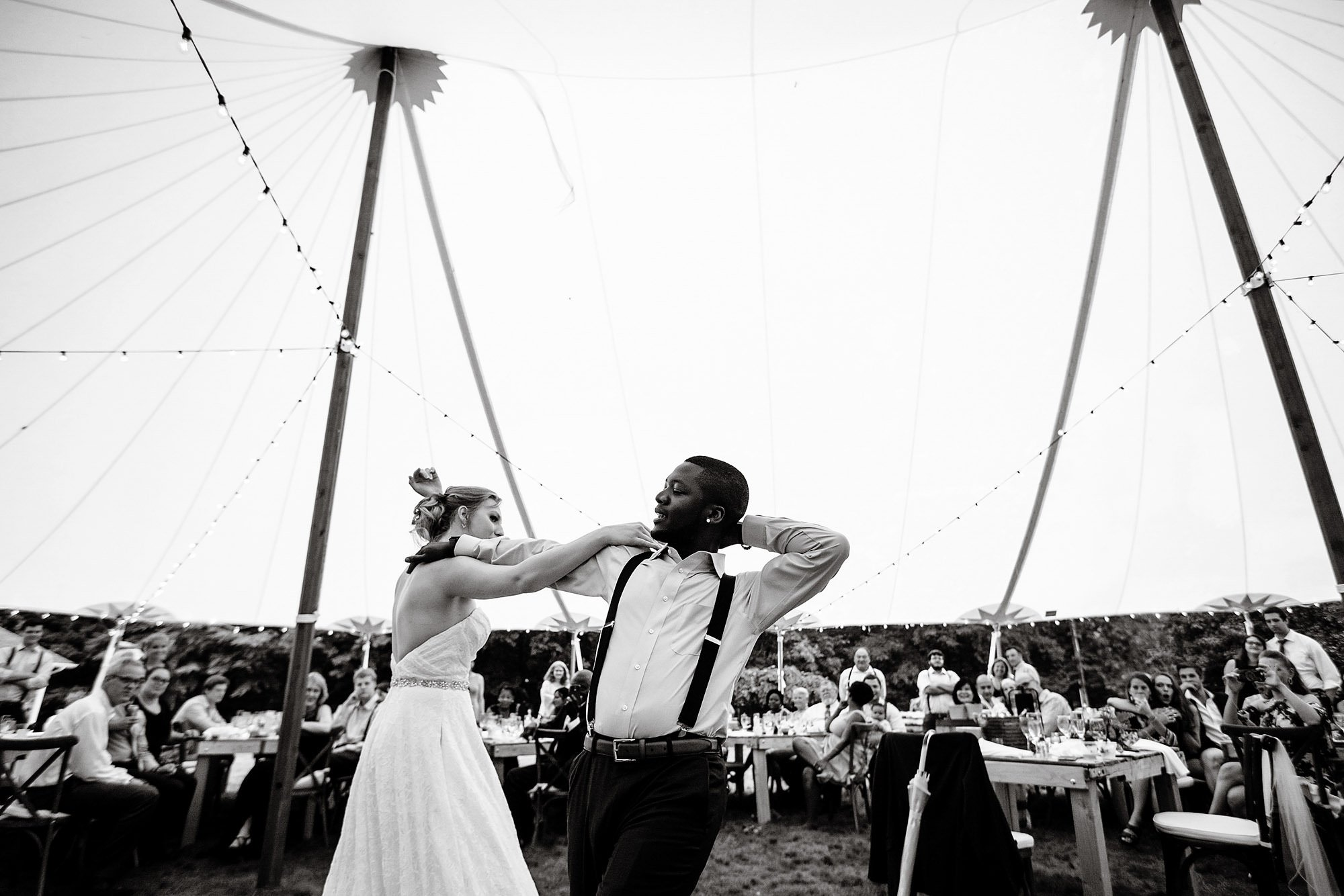 New Hampshire Backyard Wedding  I  The bride and groom dance during the tented wedding reception.