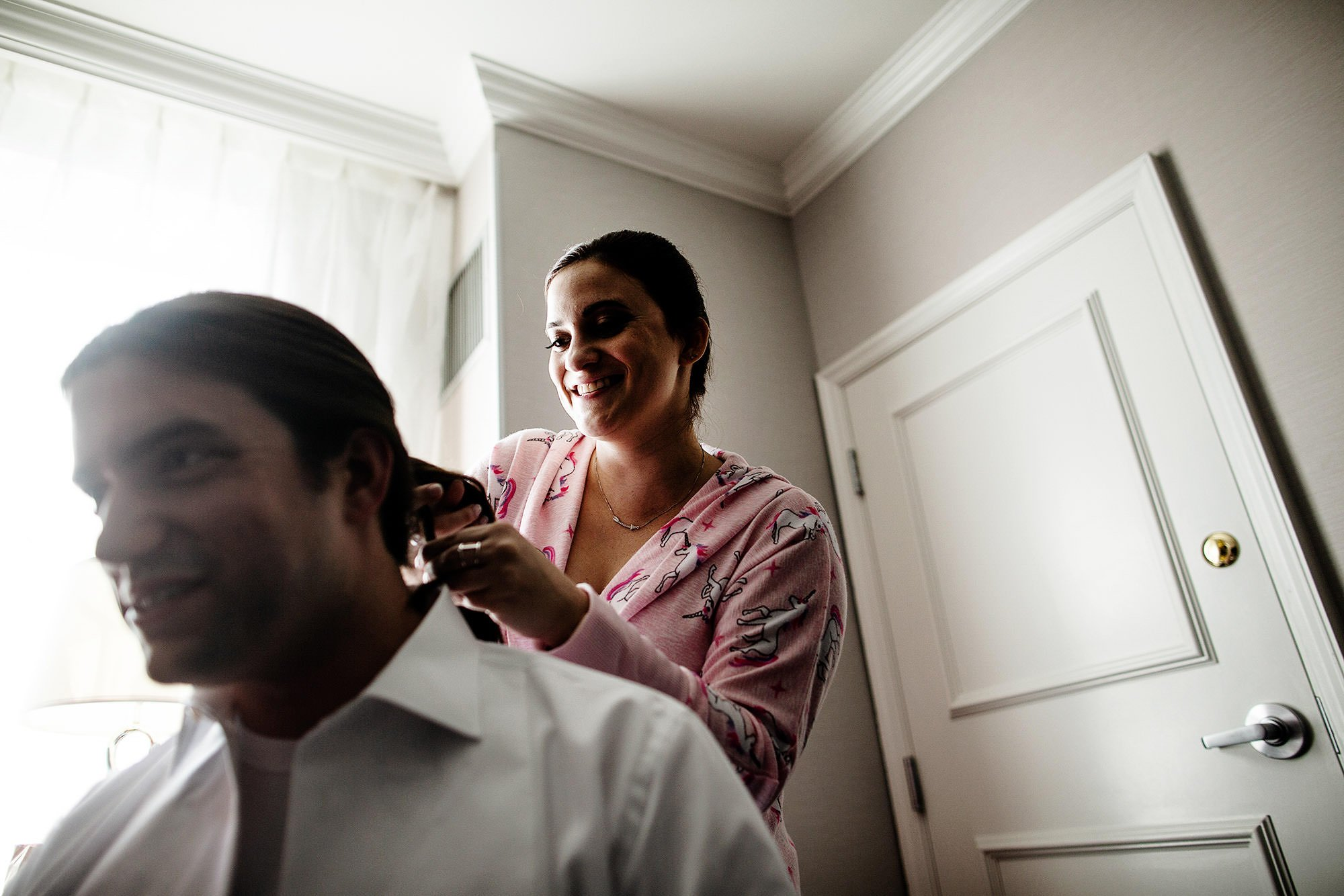 The groom get his hair done.