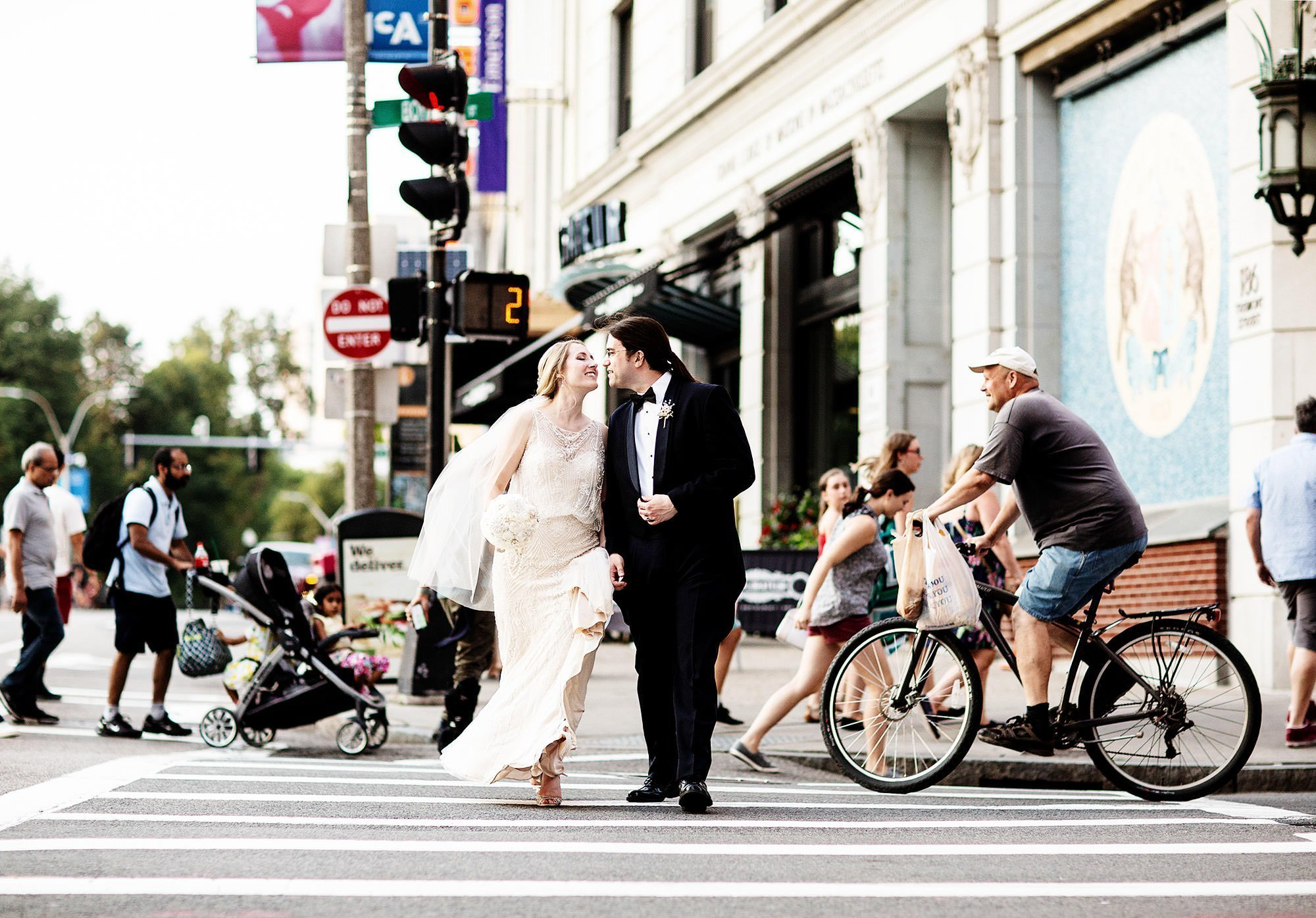 The bride and groom enter the crosswalk during their Courtyard Boston Downtown Wedding.