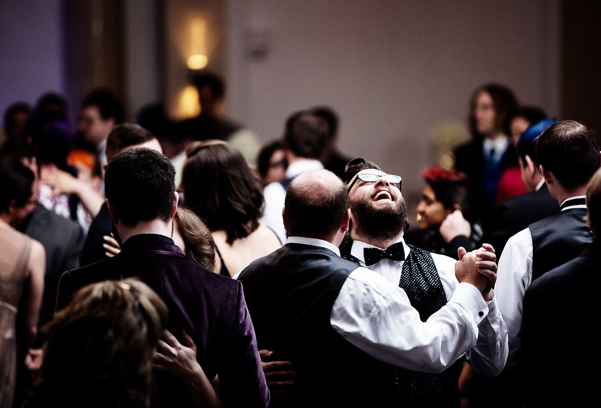 Guests dance during the wedding reception at Courtyard Boston Downtown.