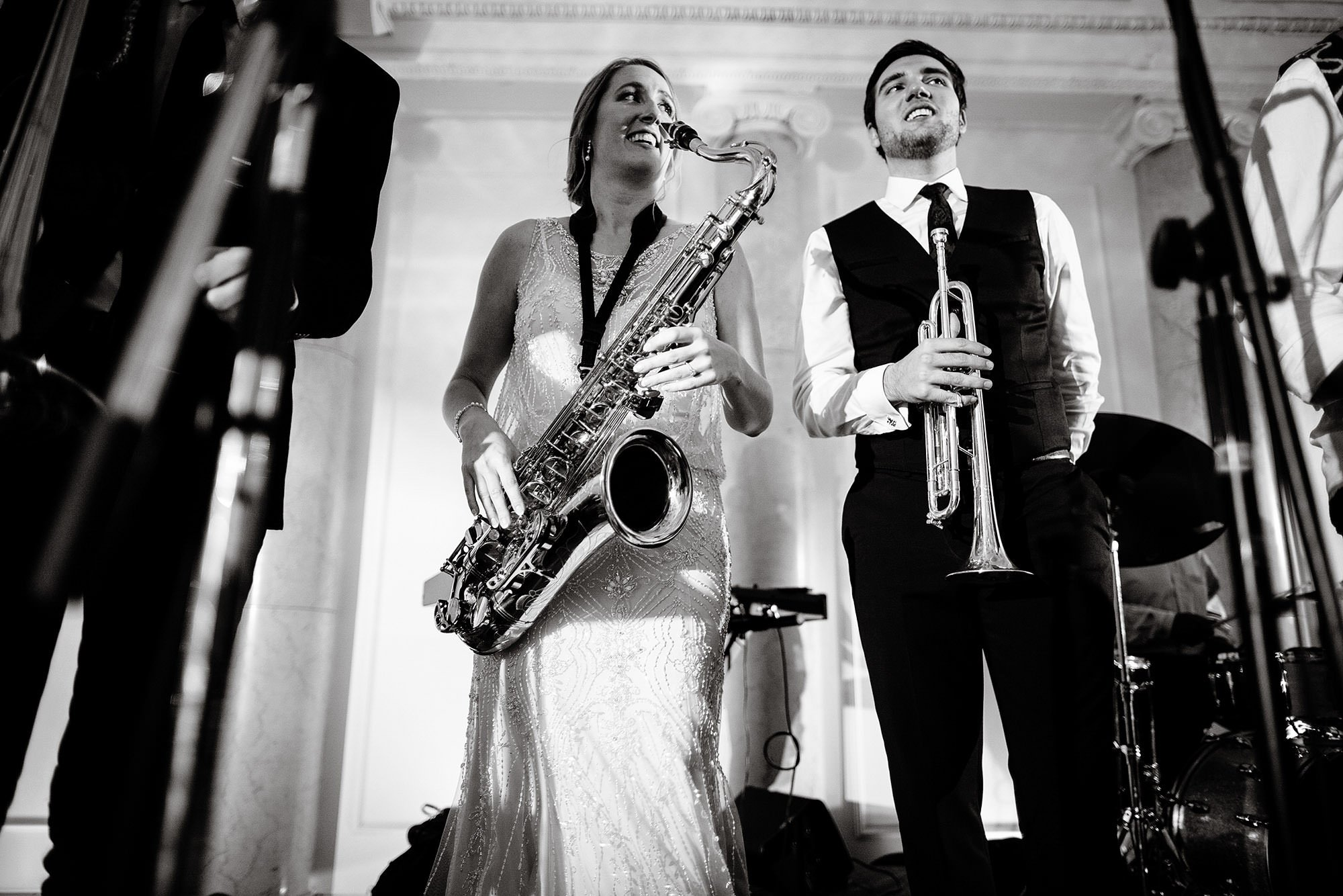The bride plays on stage with the band during this Courtyard Boston Downtown Wedding.