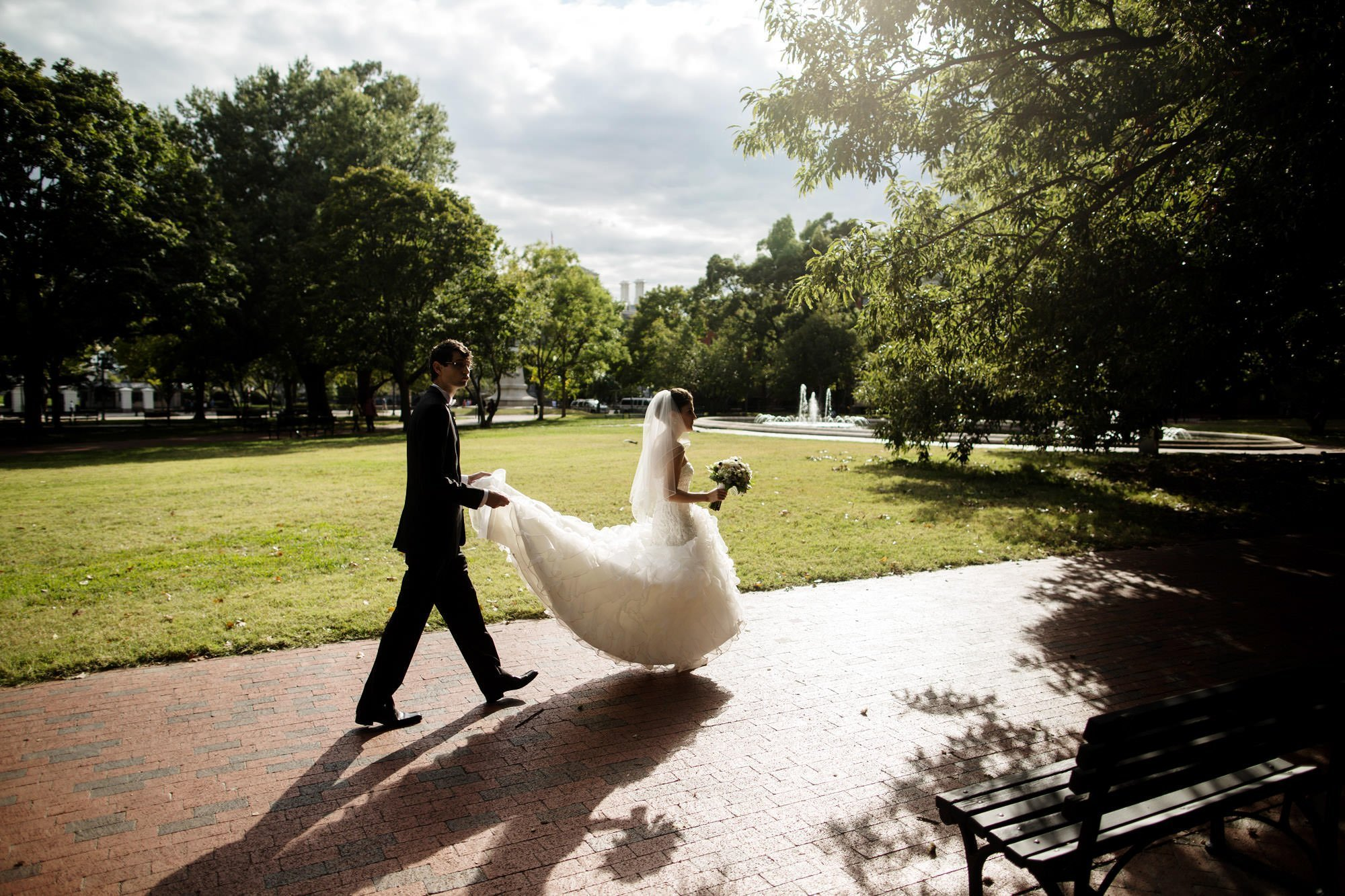 The bride and groom stroll through Lafayette Square before their Decatur House Wedding in Washington, DC.