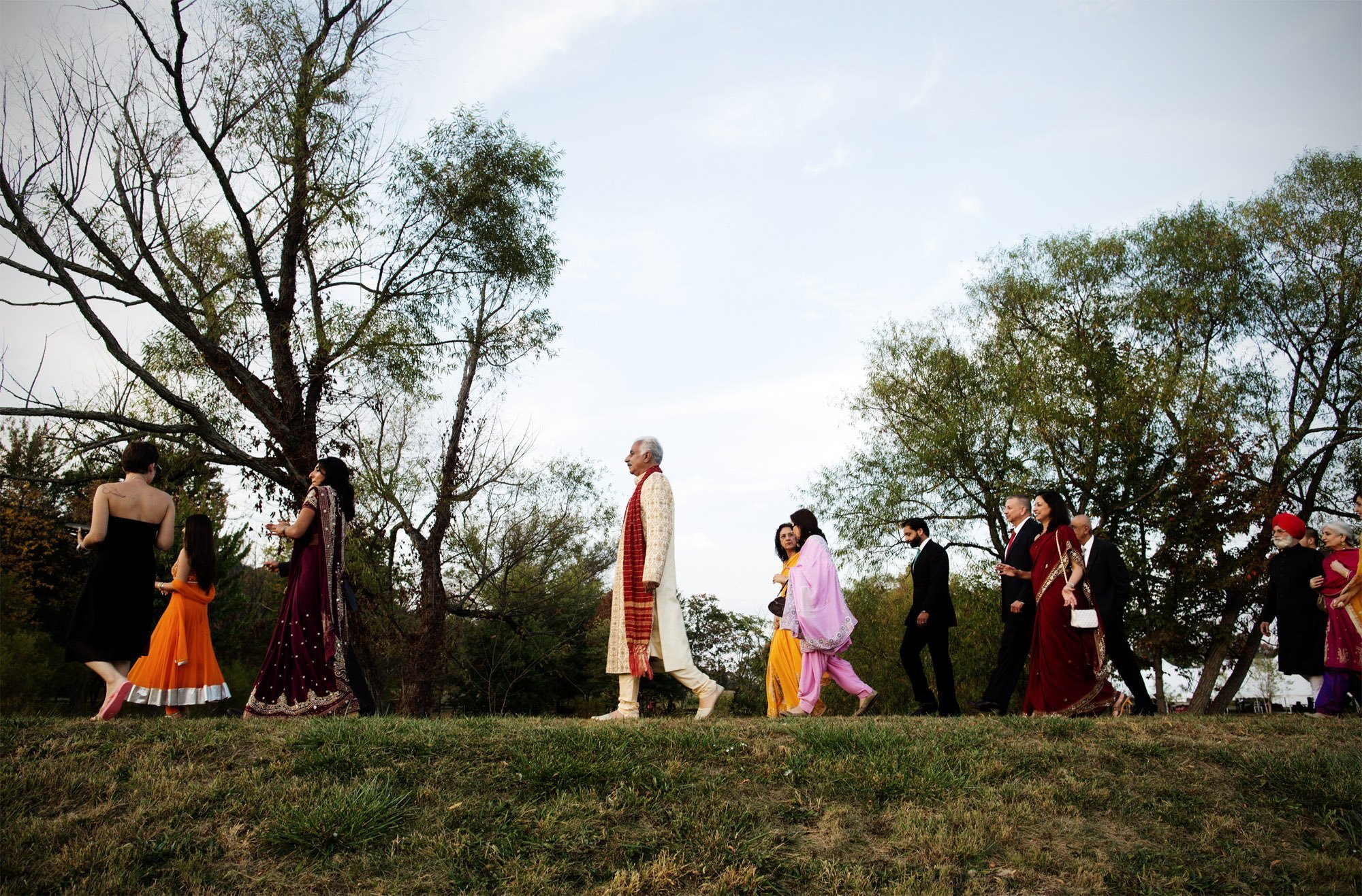 Guests participate in the baraat during this Doukenie Winery wedding.