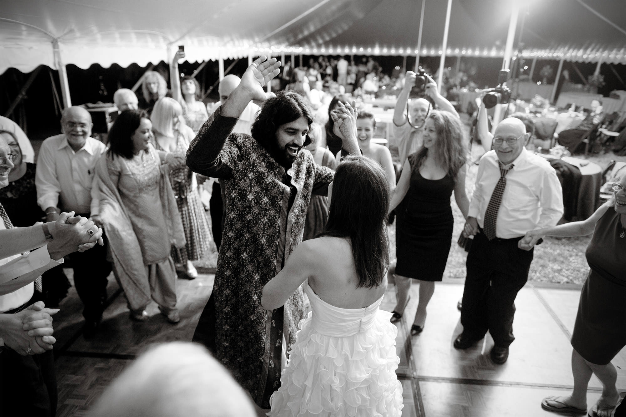 Guests dance during the wedding reception at Doukenie Winery.