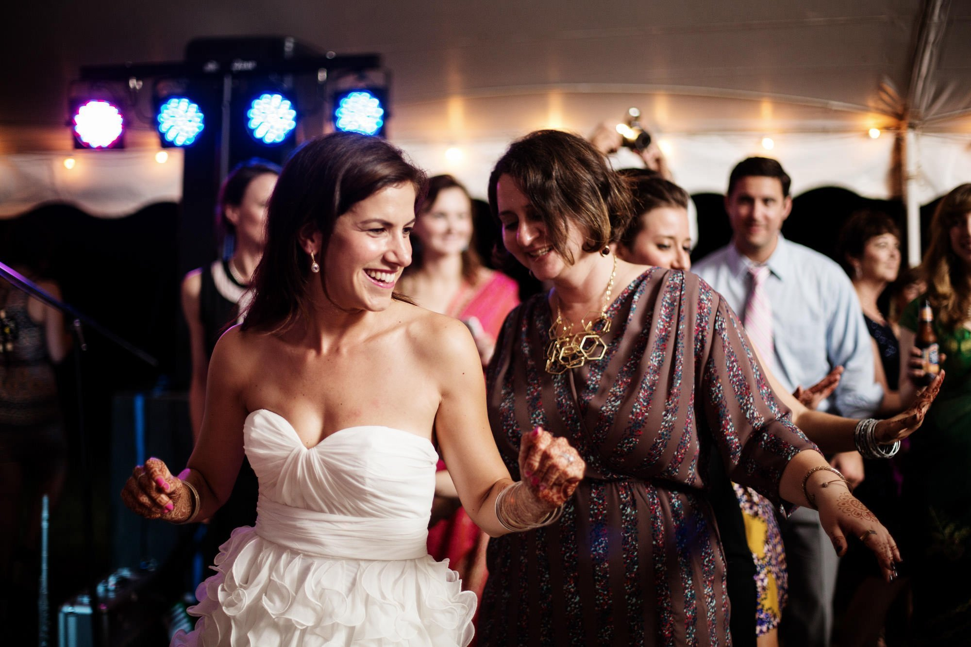 The bride dances with her guests during the wedding reception at Doukenie Winery.