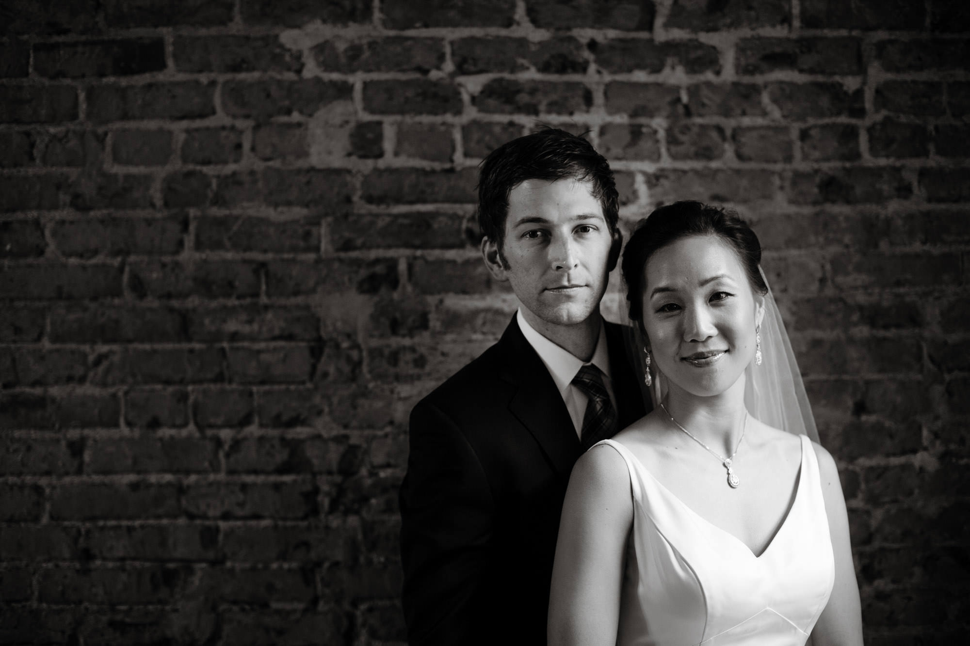 The bride and groom pose for a portrait on their wedding day at Epic Yoga Studio in Washington, DC.