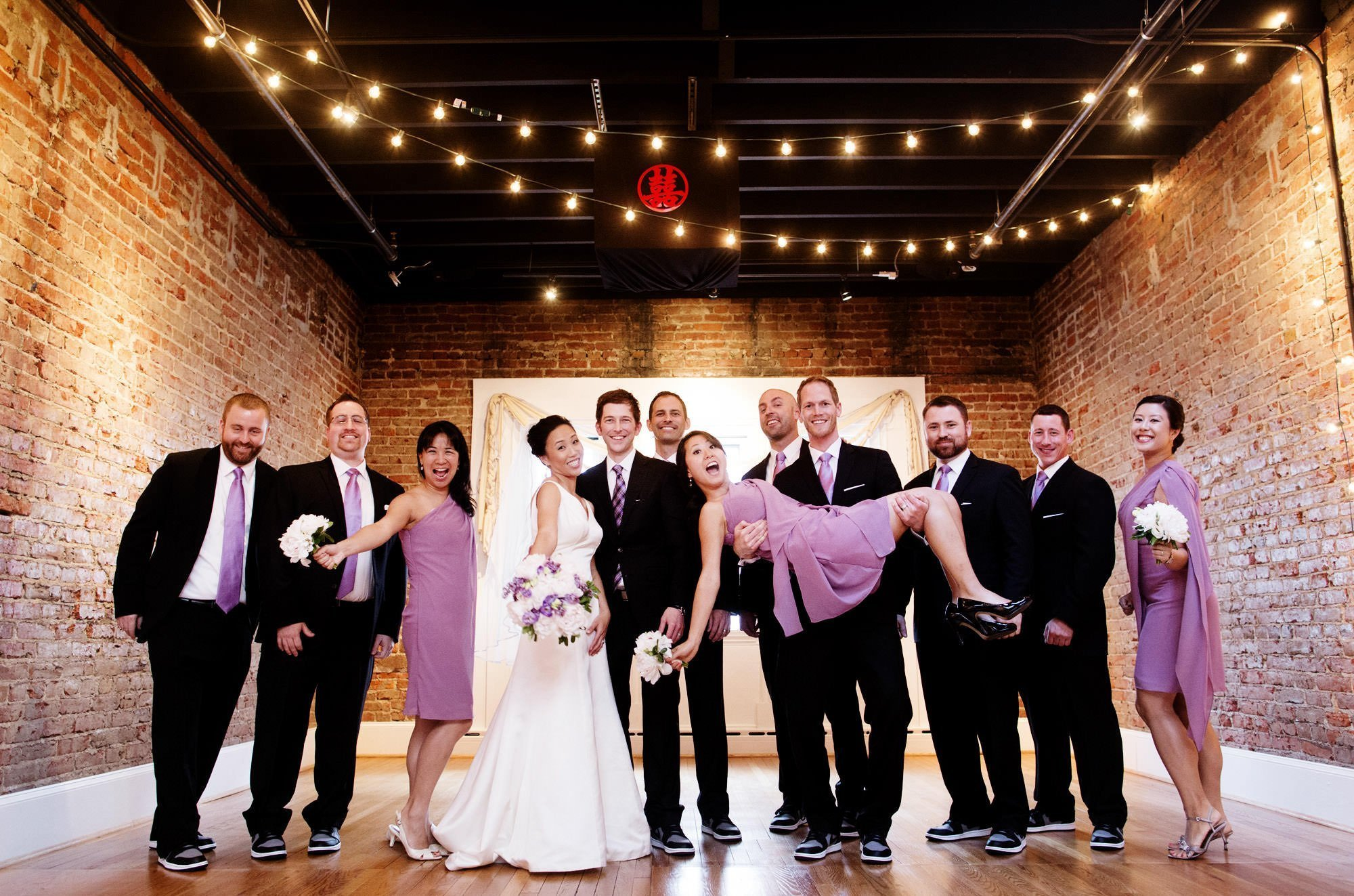 The wedding party poses at Epic Yoga Studio on the wedding day.