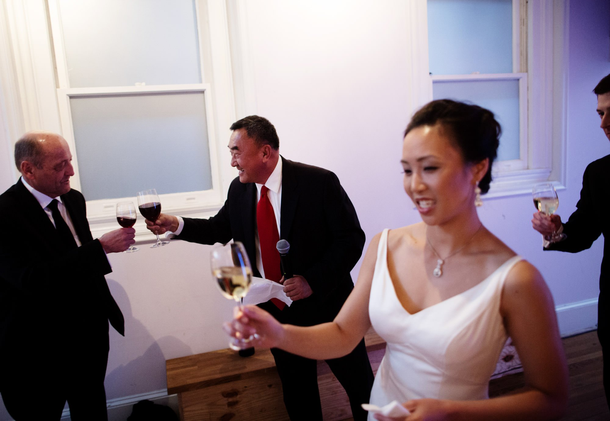 Wedding guests toast at Epic Yoga Studio.