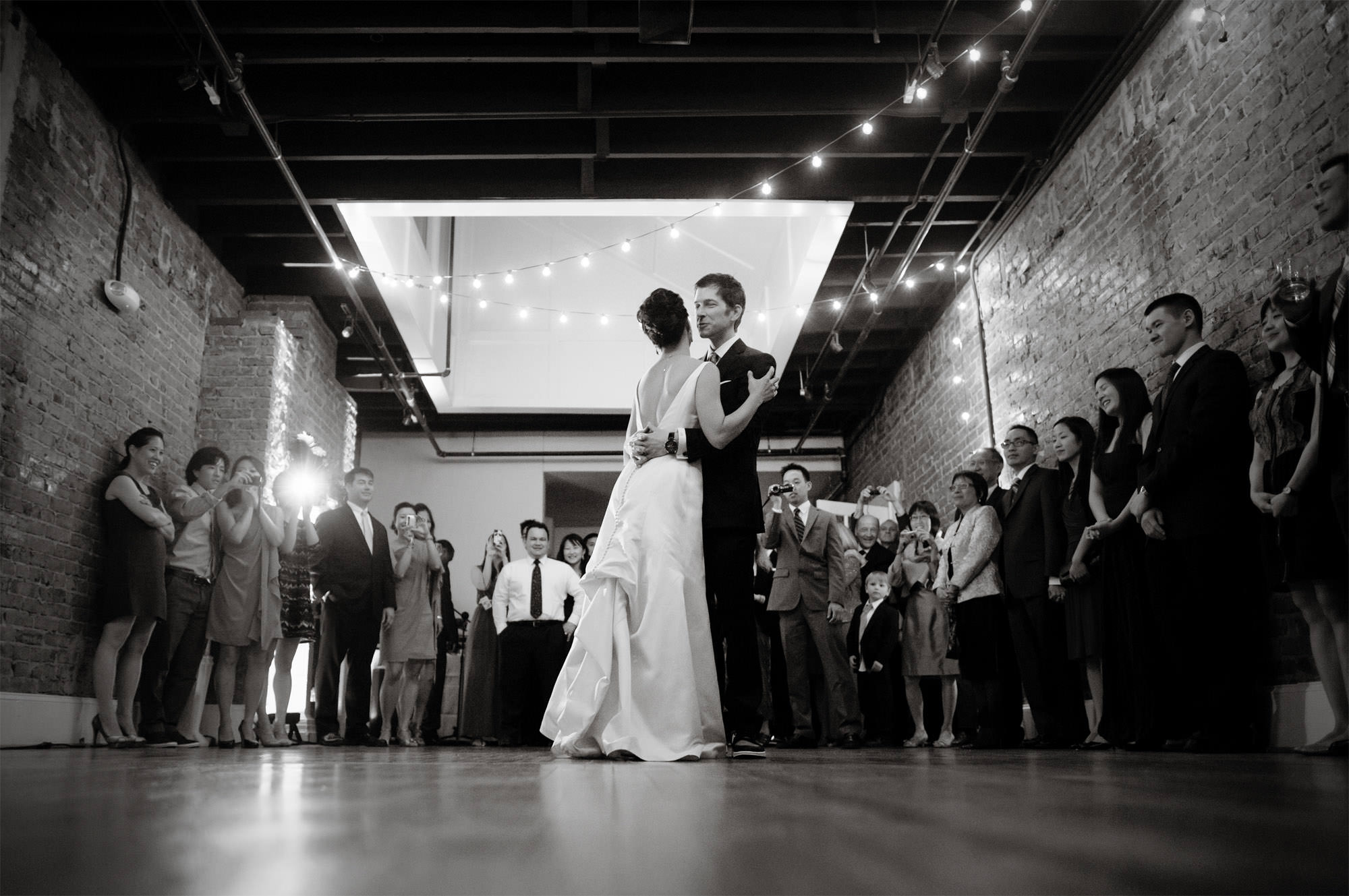 The bride and groom share their first dance during their Epic Yoga Studio wedding in DC.