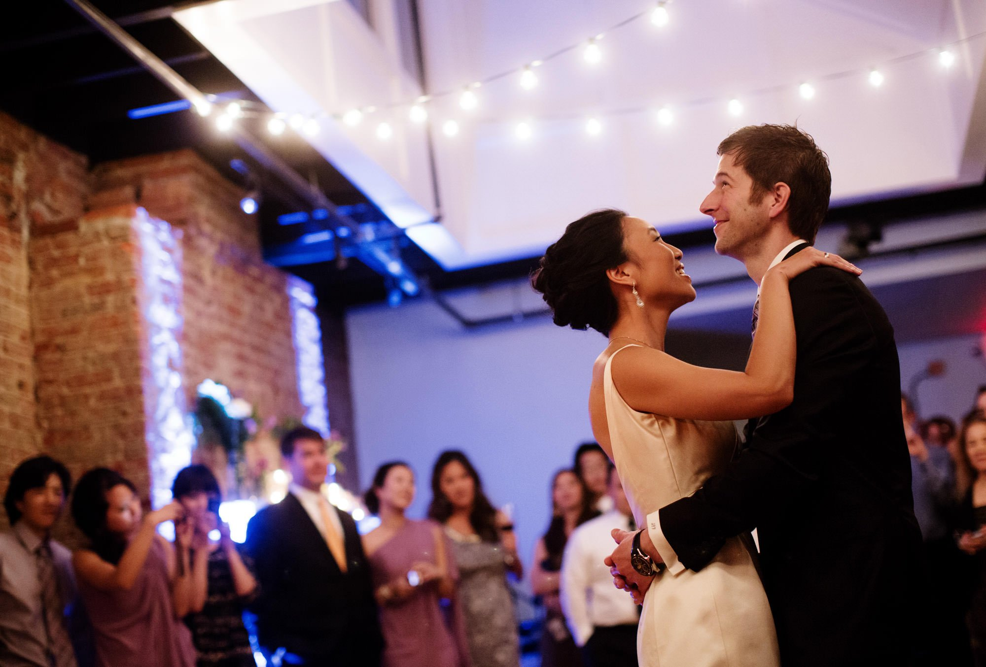 The bride and groom dance during their Epic Yoga Studio wedding in DC.