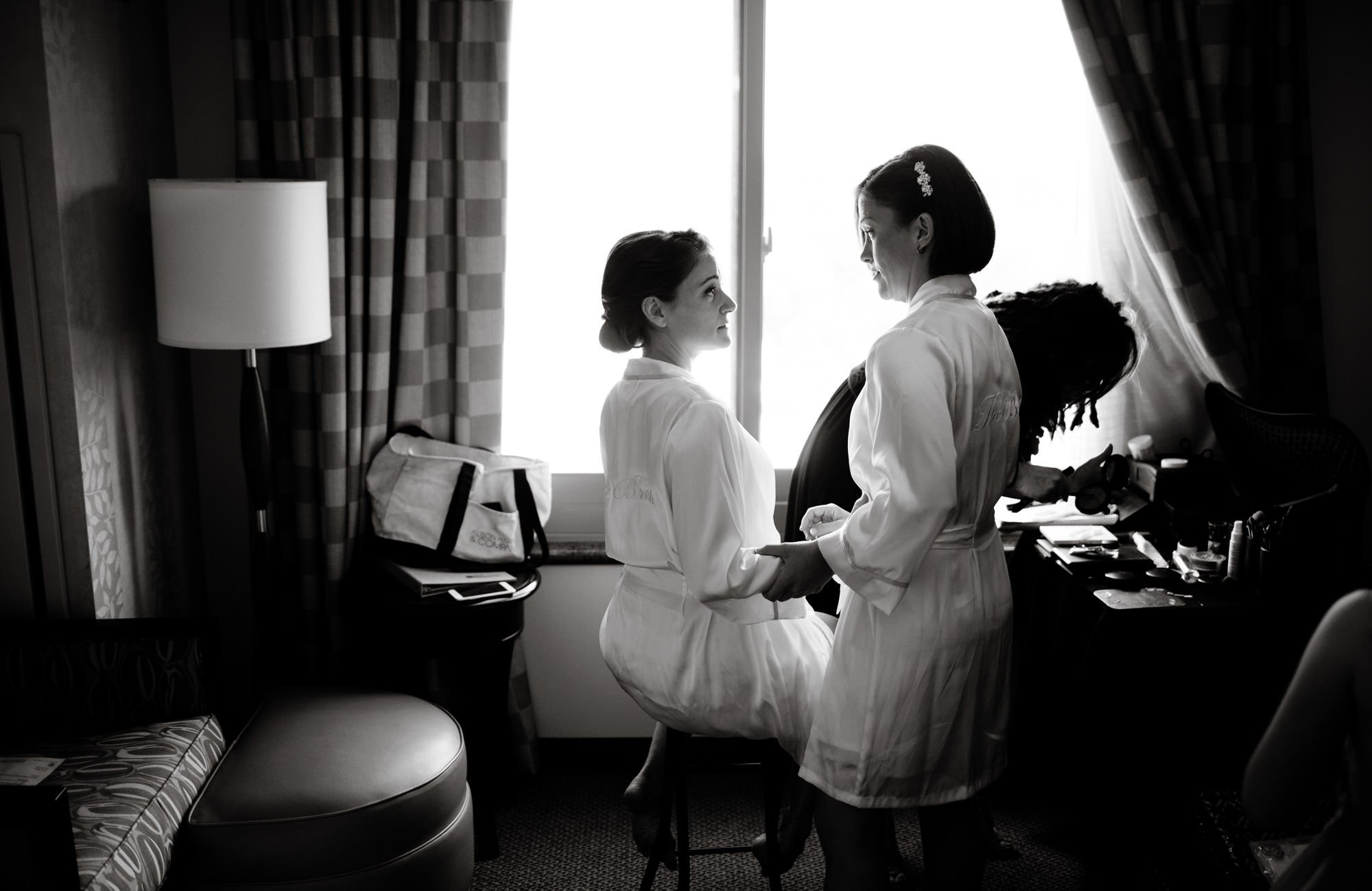 The brides get ready in their hotel room.