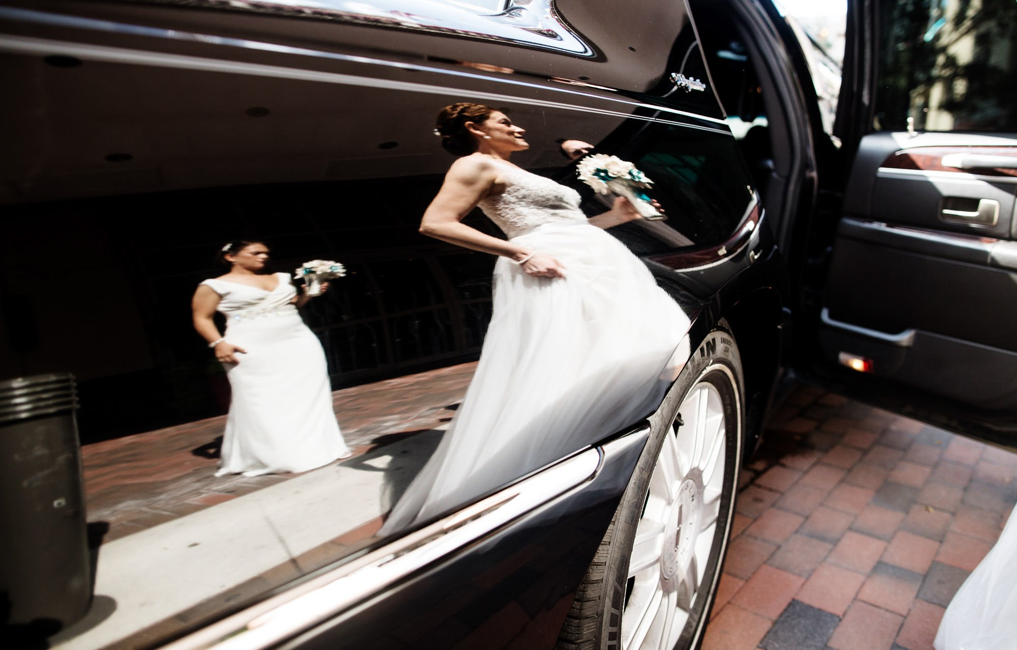The brides walk to their limousine to drive to Glen Echo Park.