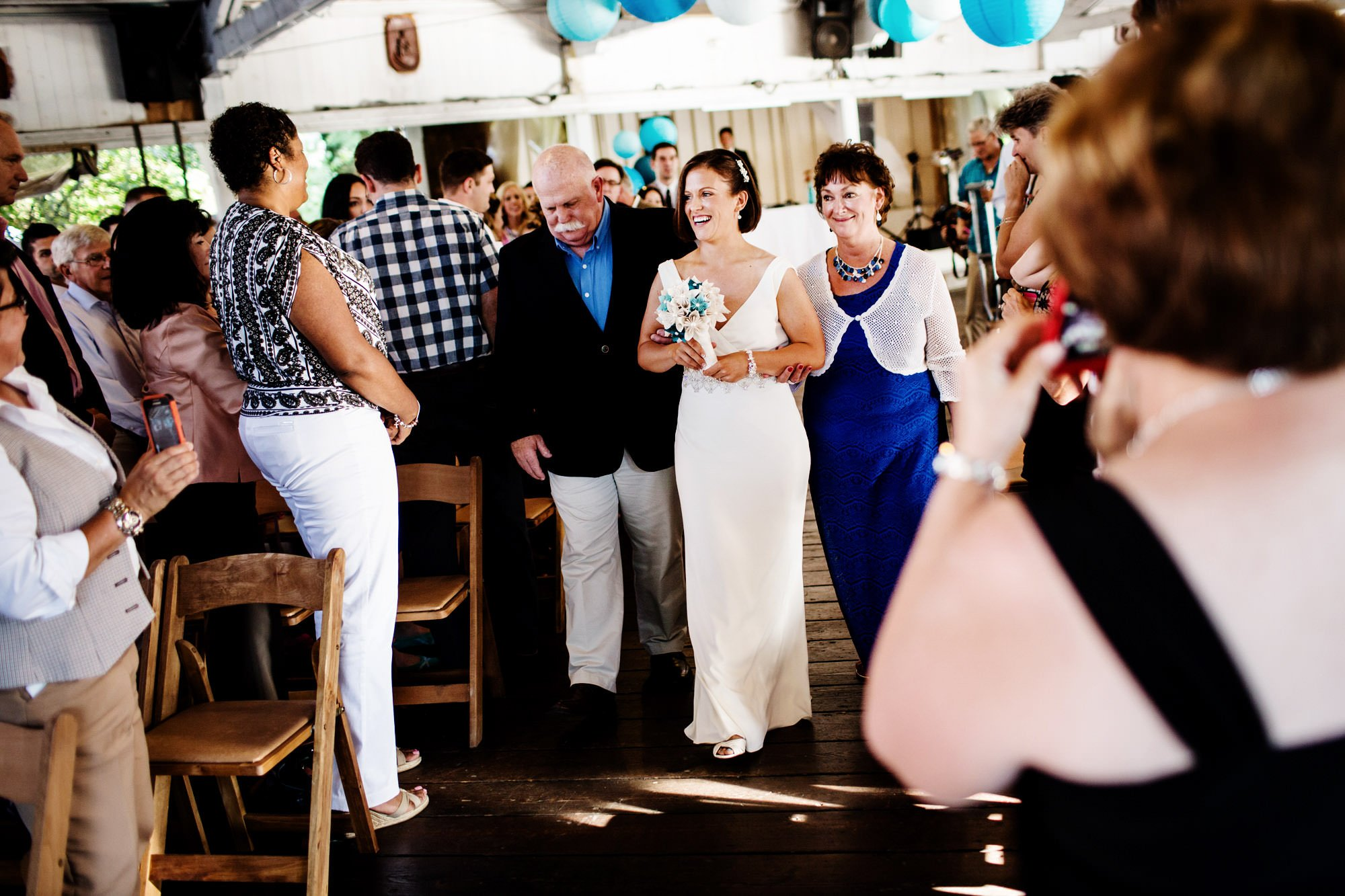 The bride walks down the aisle in the pavilion at Glen Echo Park.