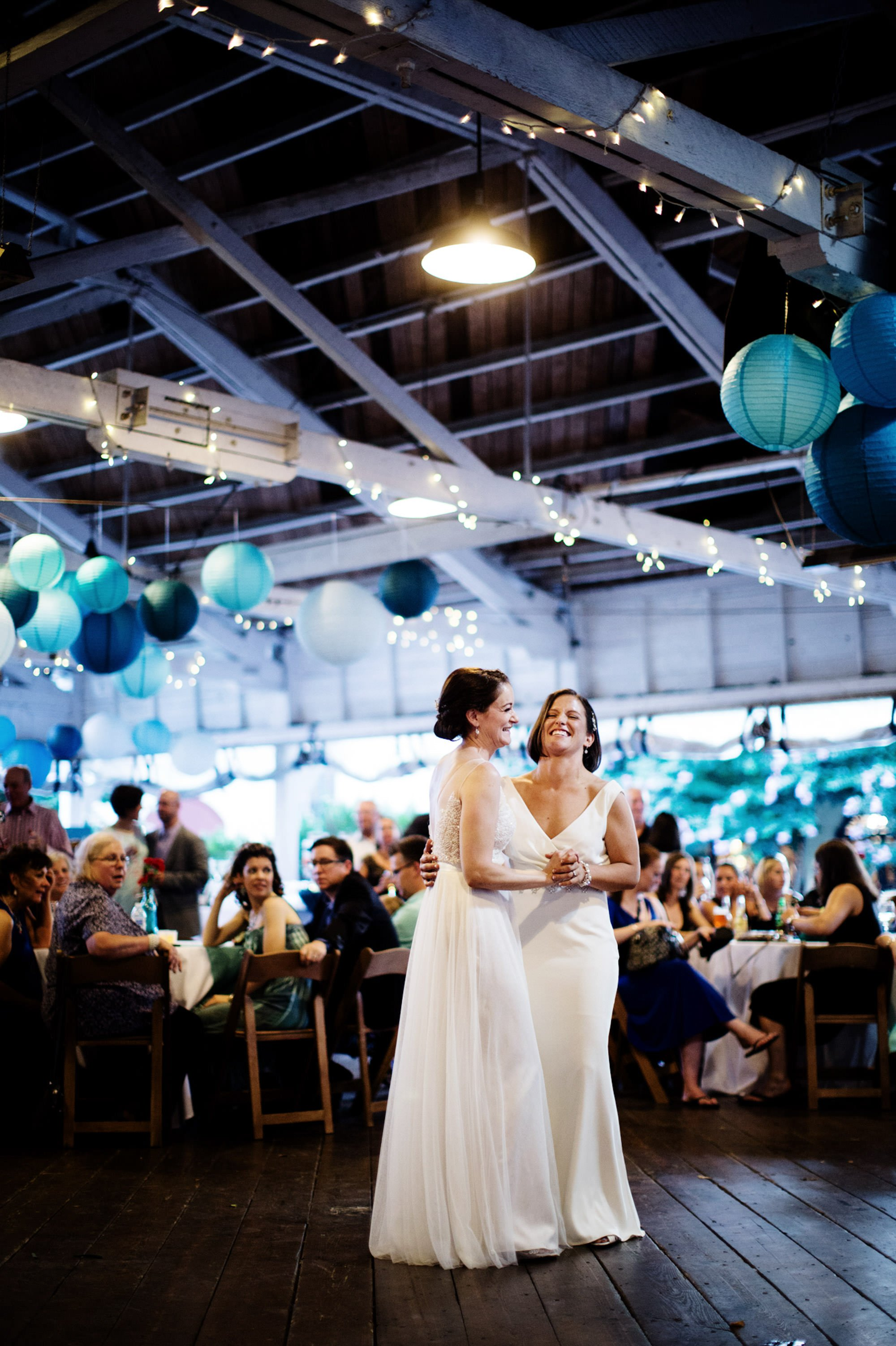 The brides share their first dance in the Bumper Car Pavilion.