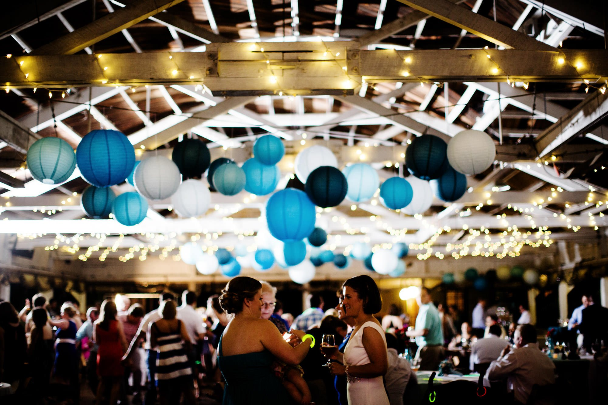 Guests enjoy the wedding reception at the Bumper Car Pavilion in Glen Echo Park.