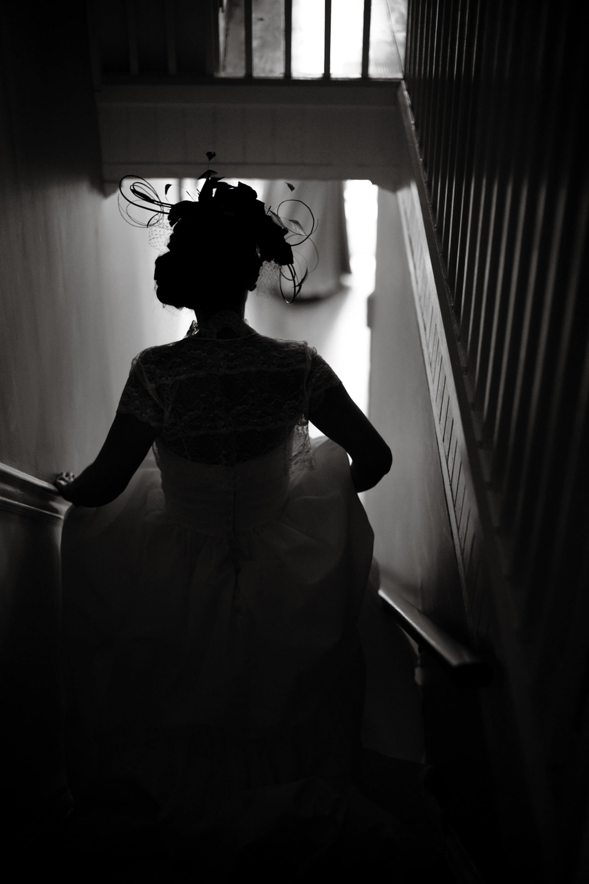 The bride walks down a stairwell.