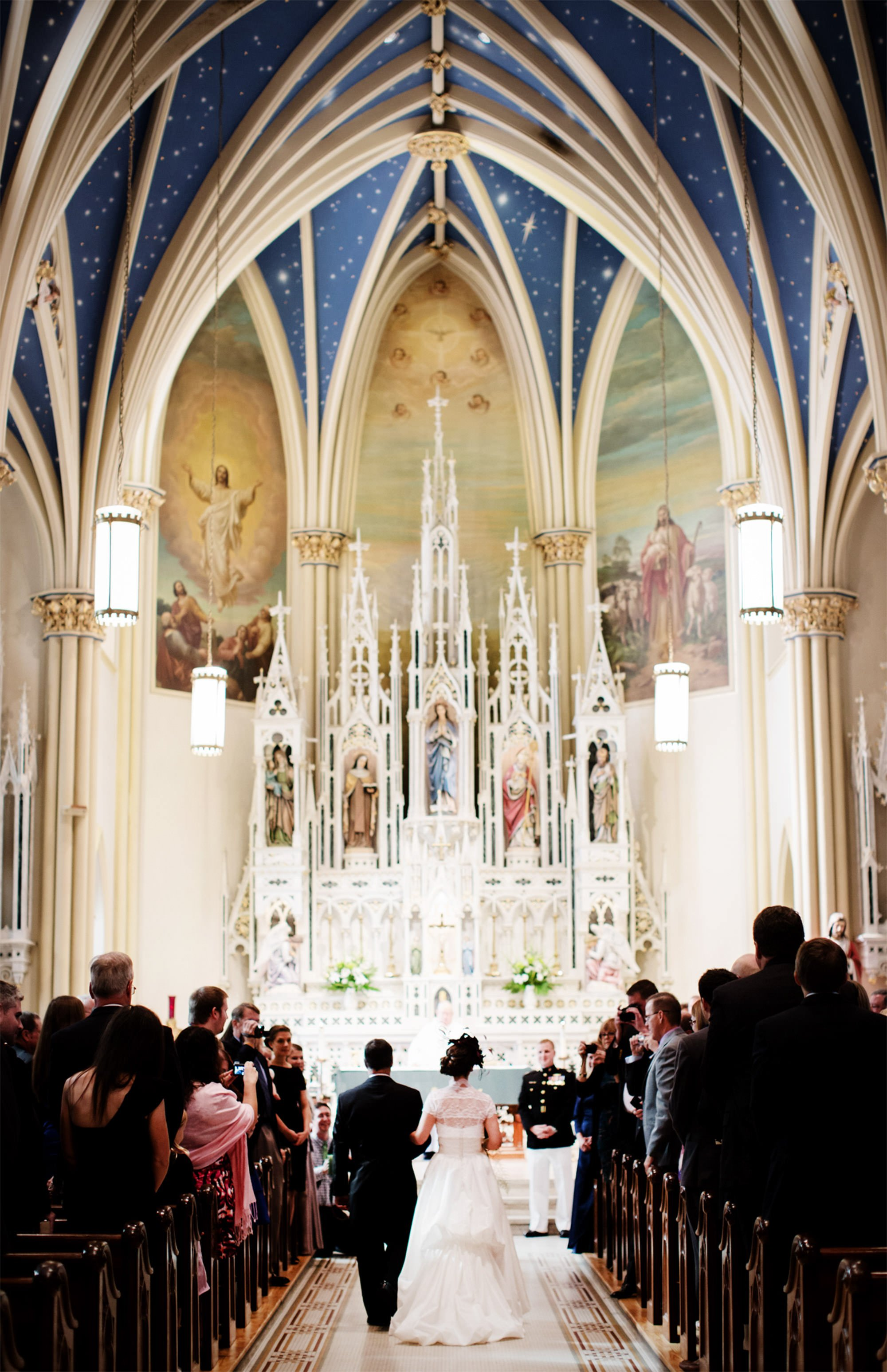The bride is escorted down the aisle at St. Mary's Catholic Church during her wedding in Annapolis.