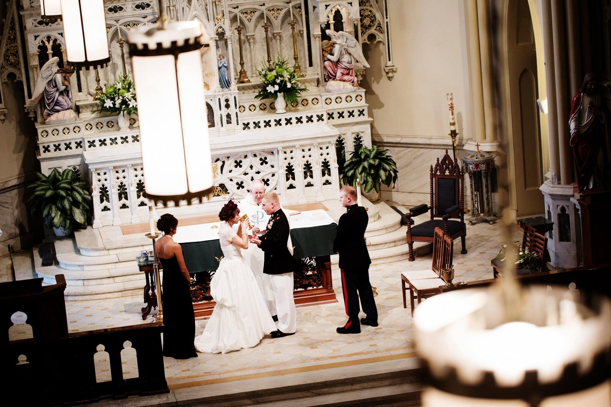 The bride and groom during their wedding ceremony at St. Mary's Catholic Church.