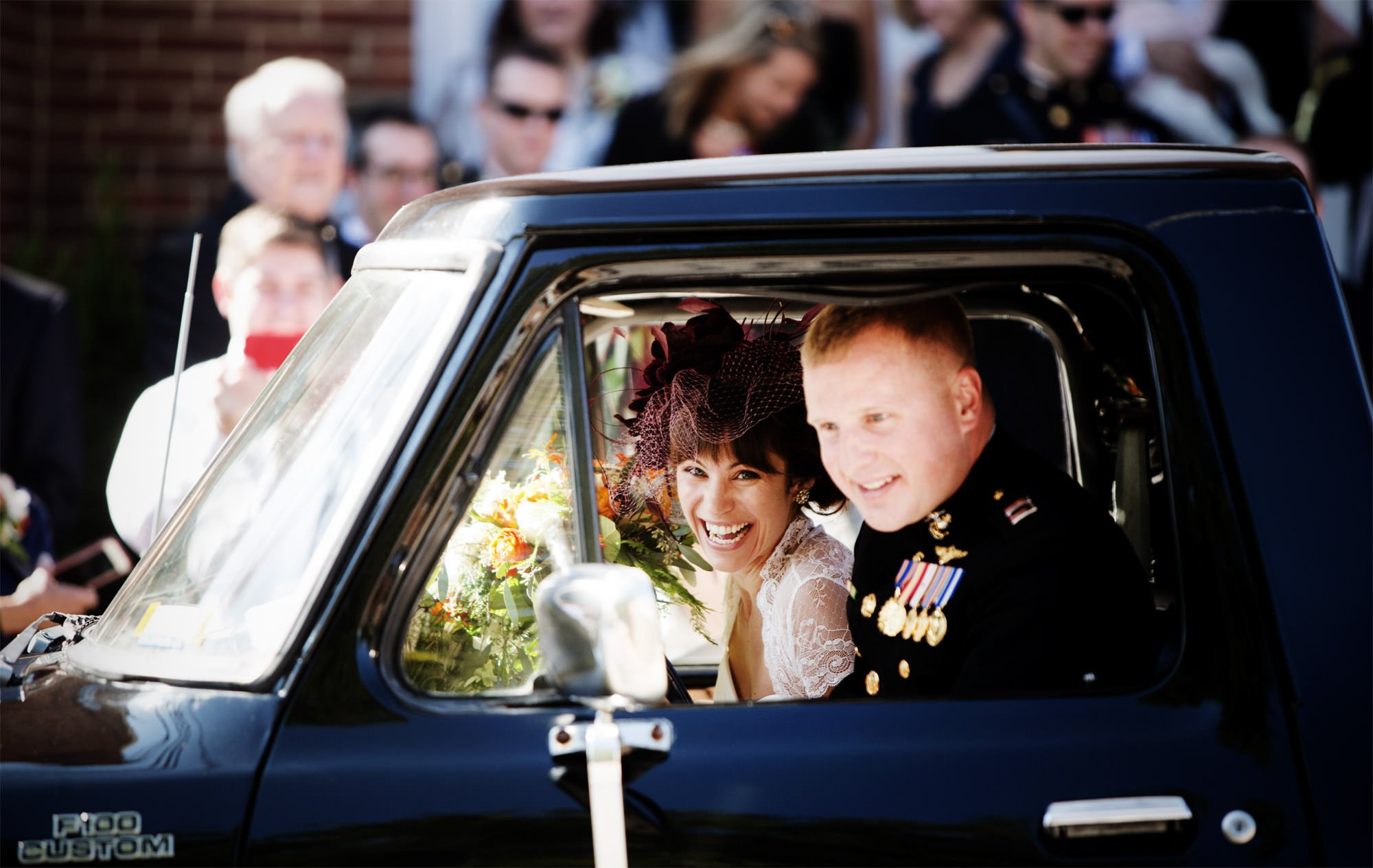 The bride and groom drive to their Governor Calvert House wedding following the ceremony in Annapolis, MD.