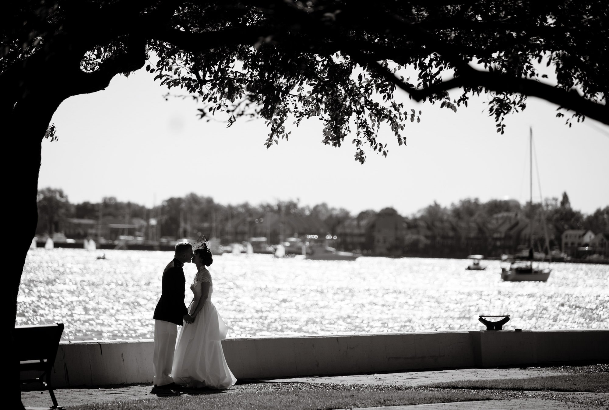 The bride and groom kiss at the Annapolis Naval Academy.