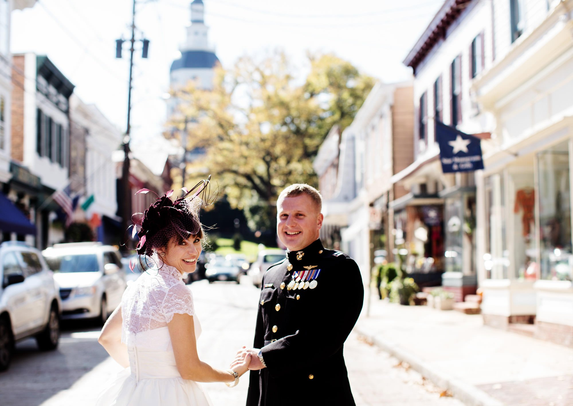 The bride and groom walk down the streets of Annapolis during their Governor Calvert House wedding.