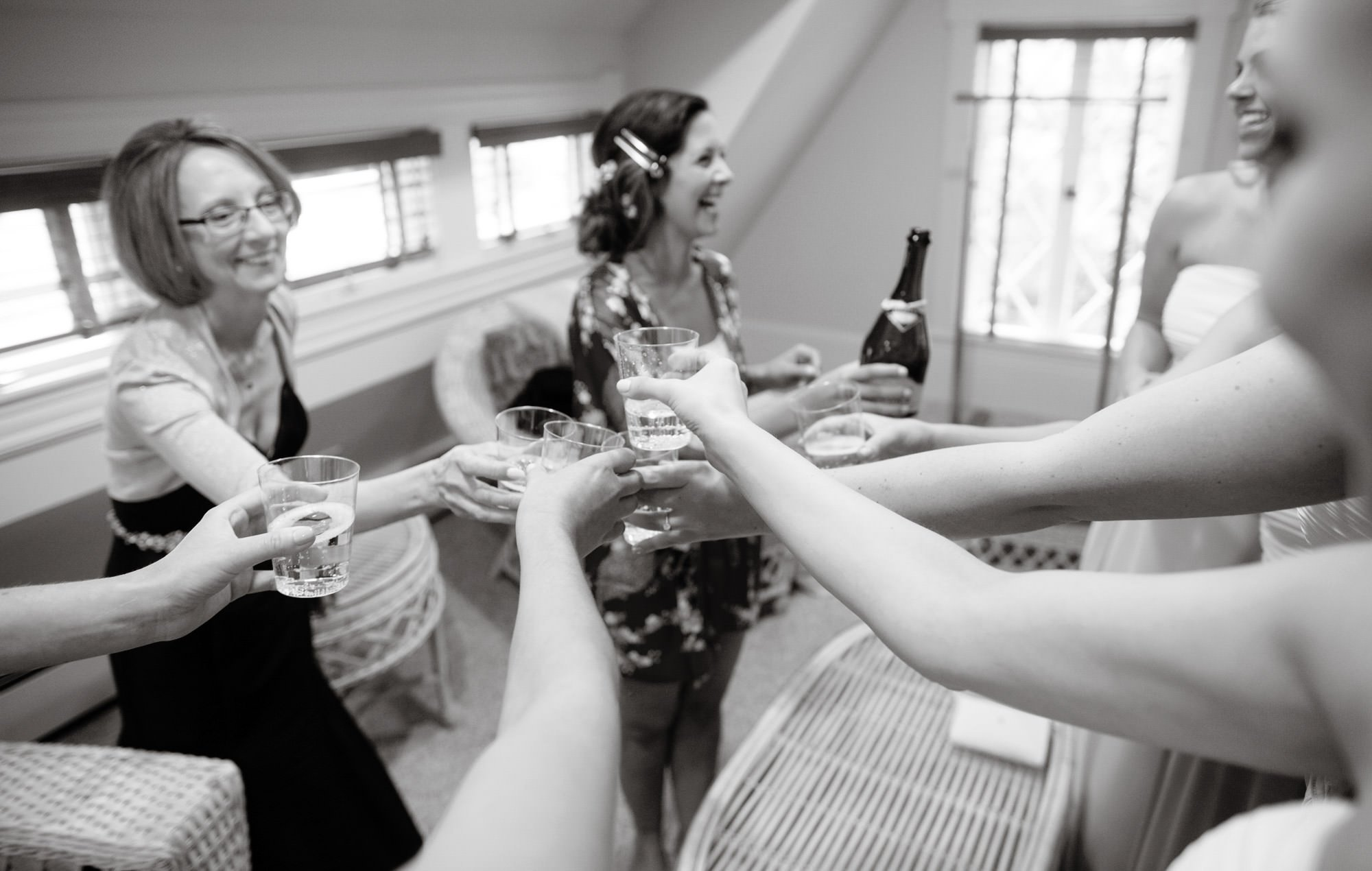 Bridesmaids give a toast prior to the wedding ceremony at Hendry House in Arlington, VA.