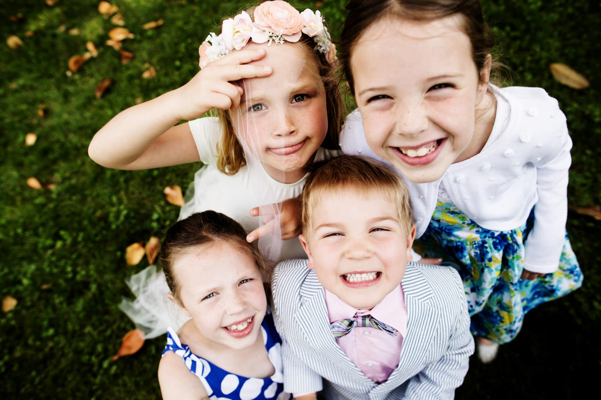 A portrait of flower girls and ring bearers.