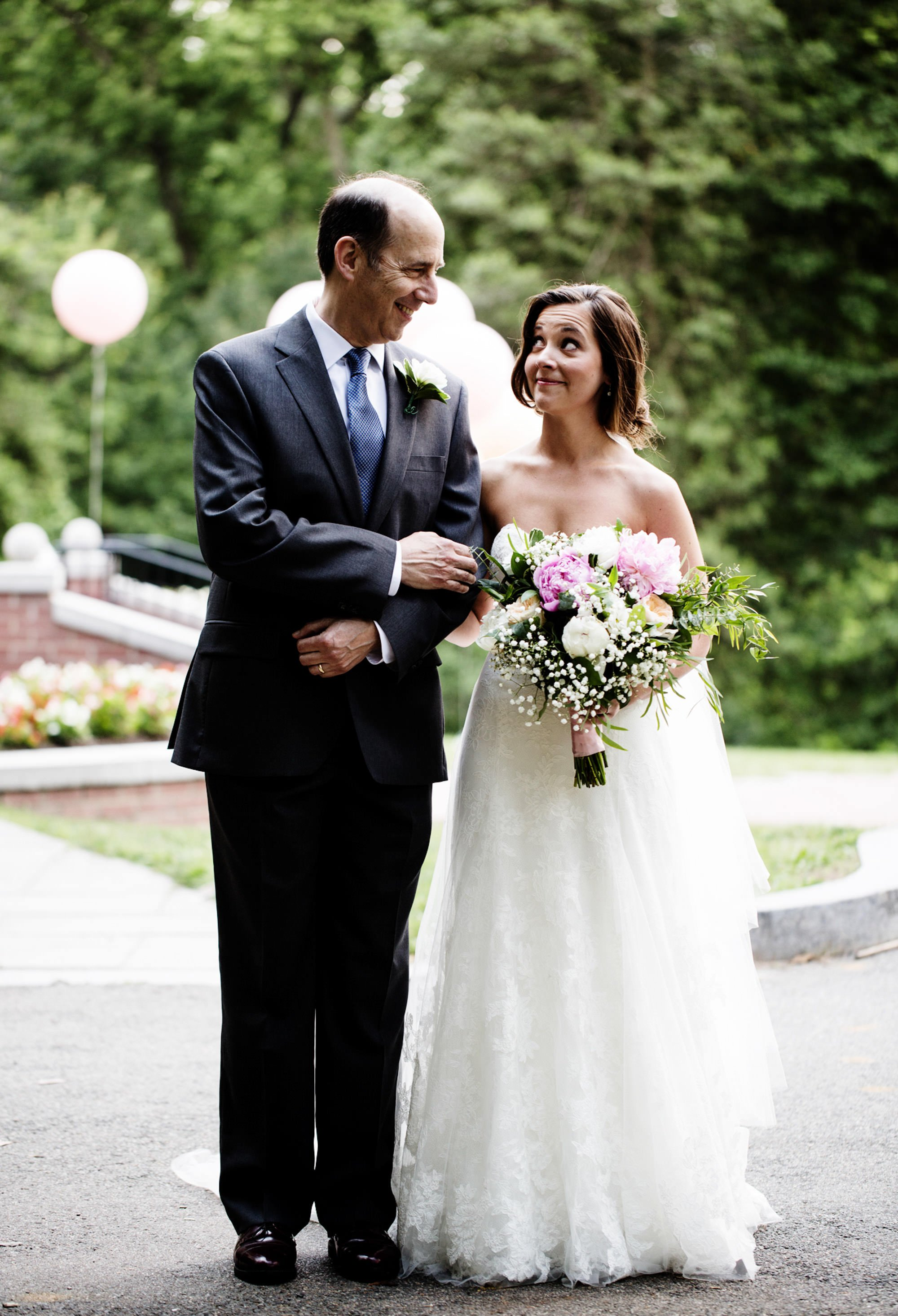 The father of the bride smiles at his daughter prior to the wedding ceremony.